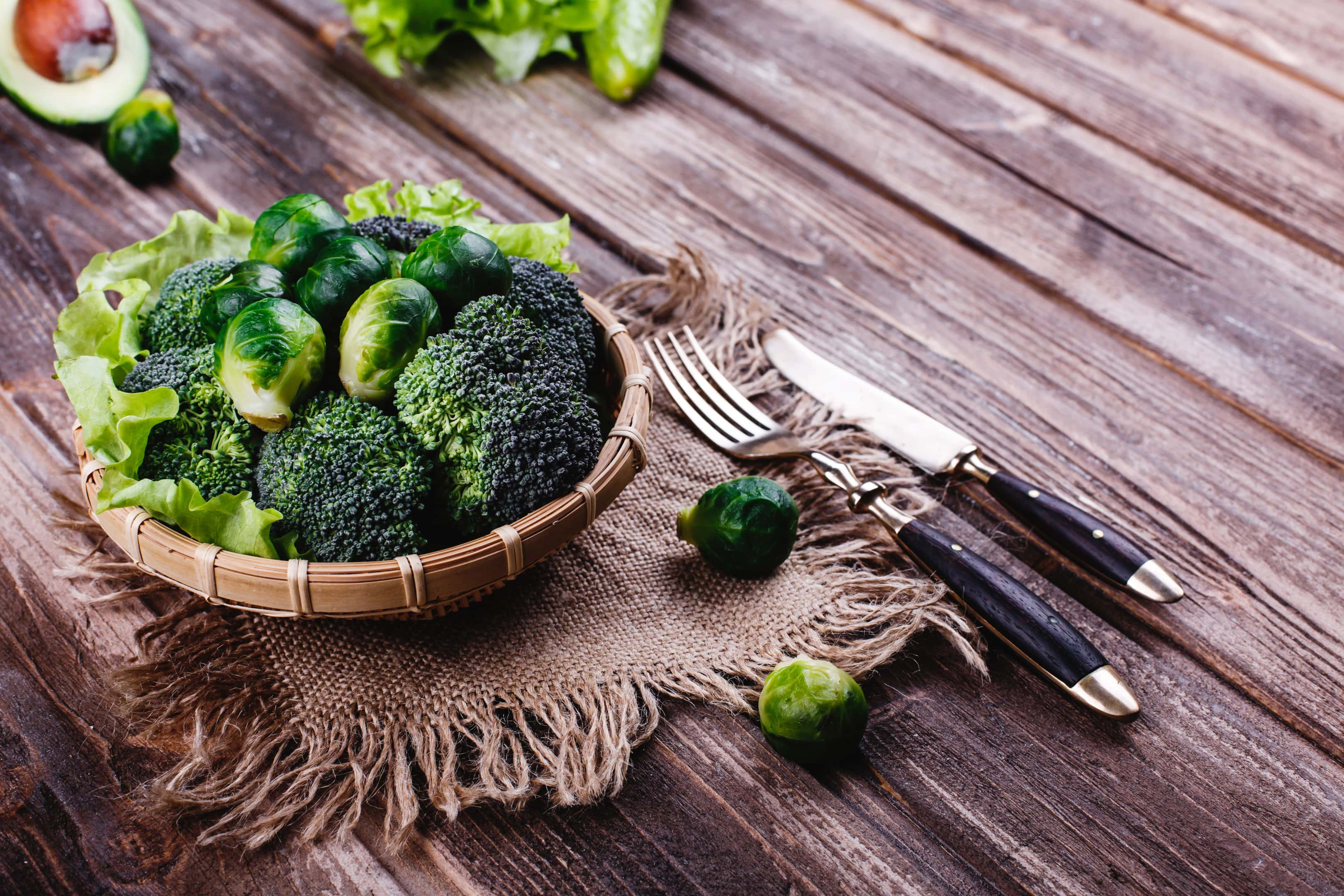 Wooden bowl with broccoli and brussel sprou