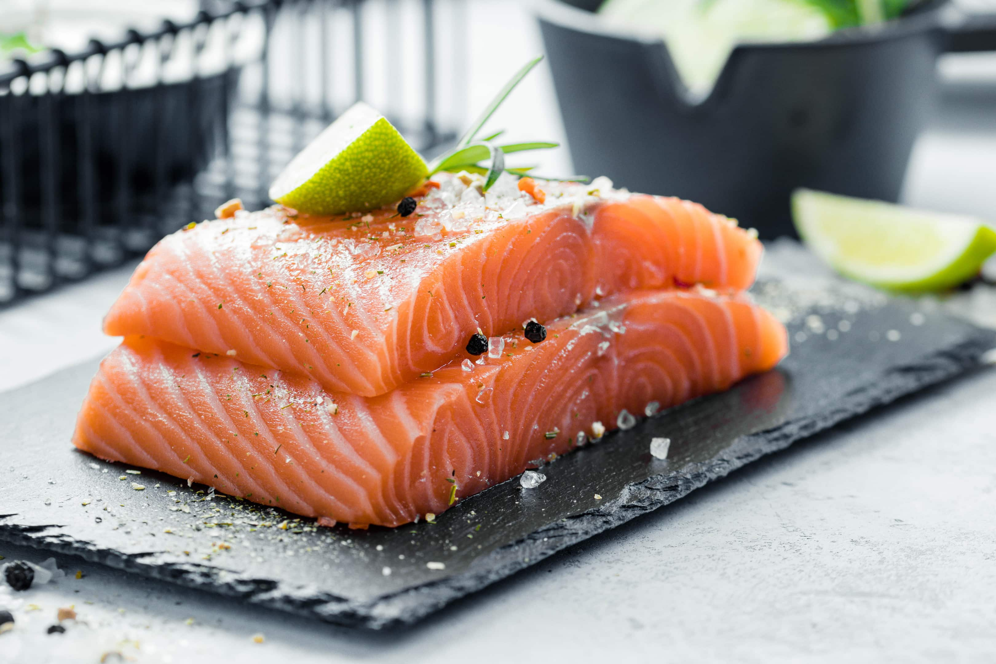 Two pieces of raw salmon fillet