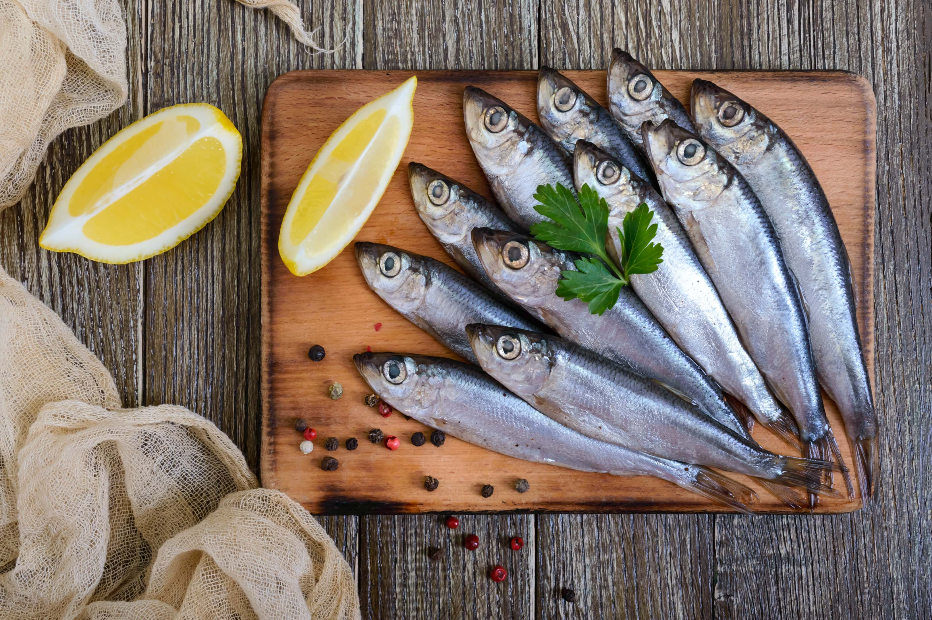 Sardines on wooden board