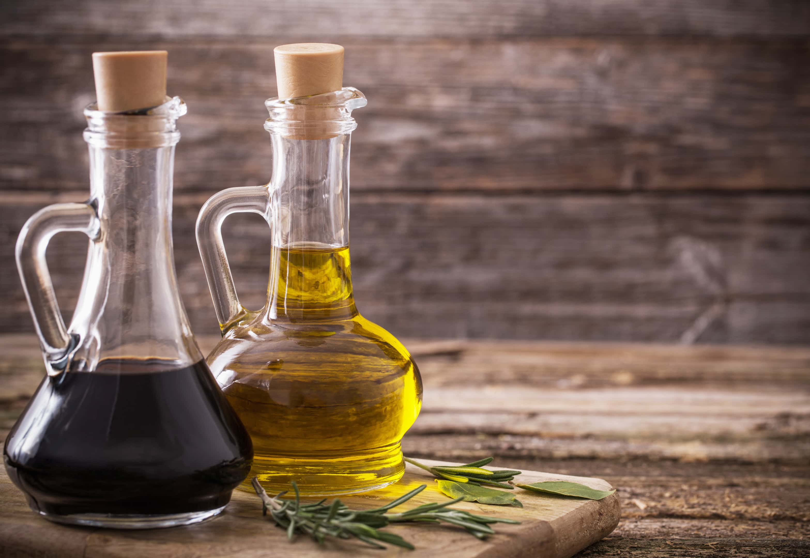 Balsamic vinegar and olive oil on wooden table