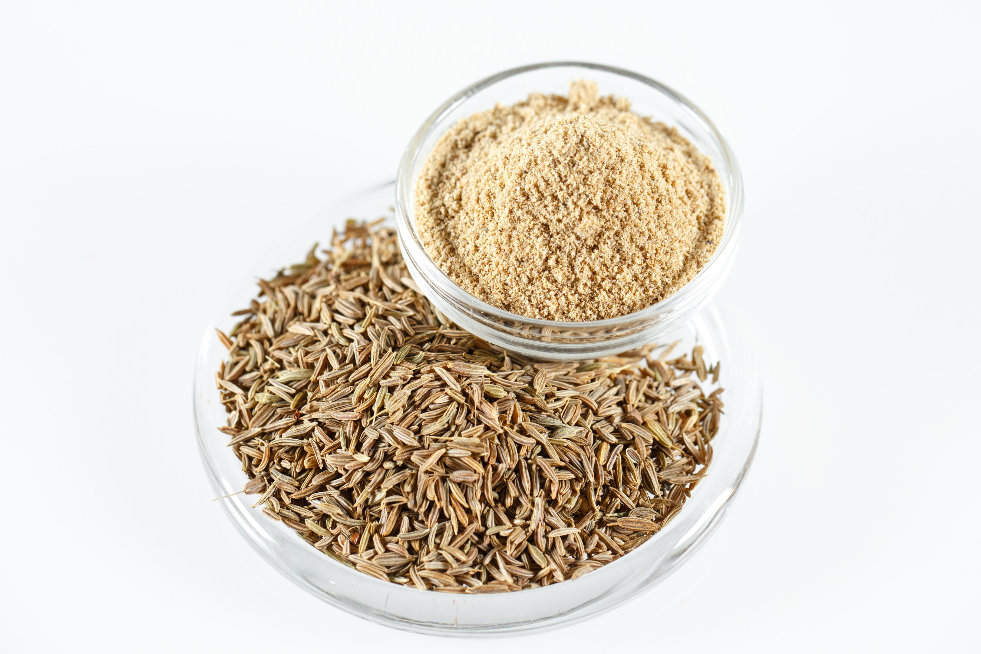 Cumin seeds and ground cumin in bowls