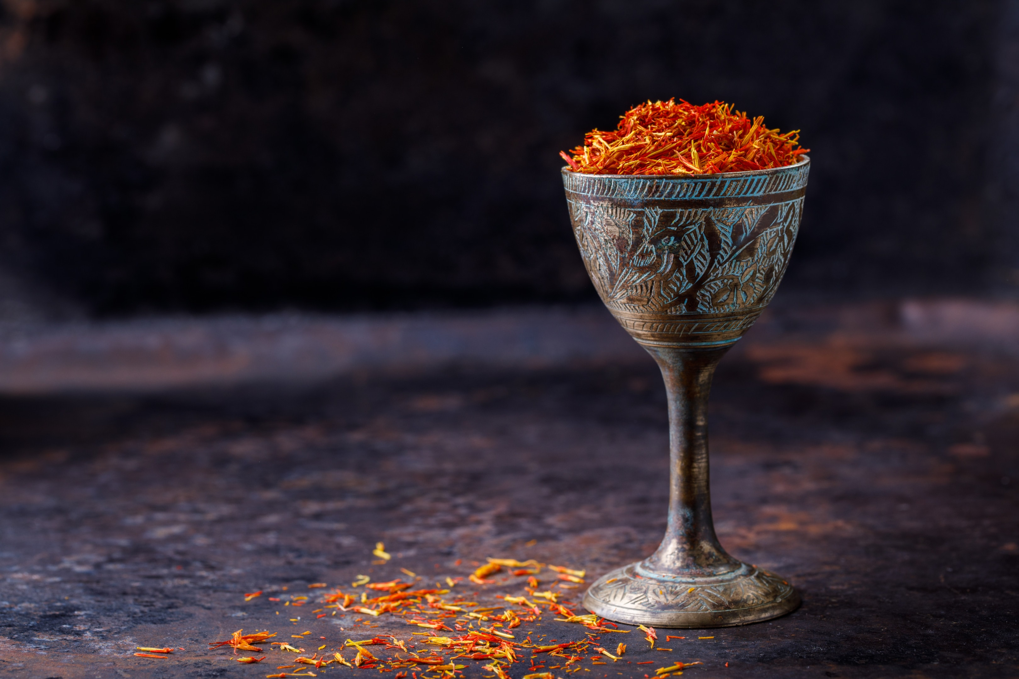 Dried saffron spice in metal glass
