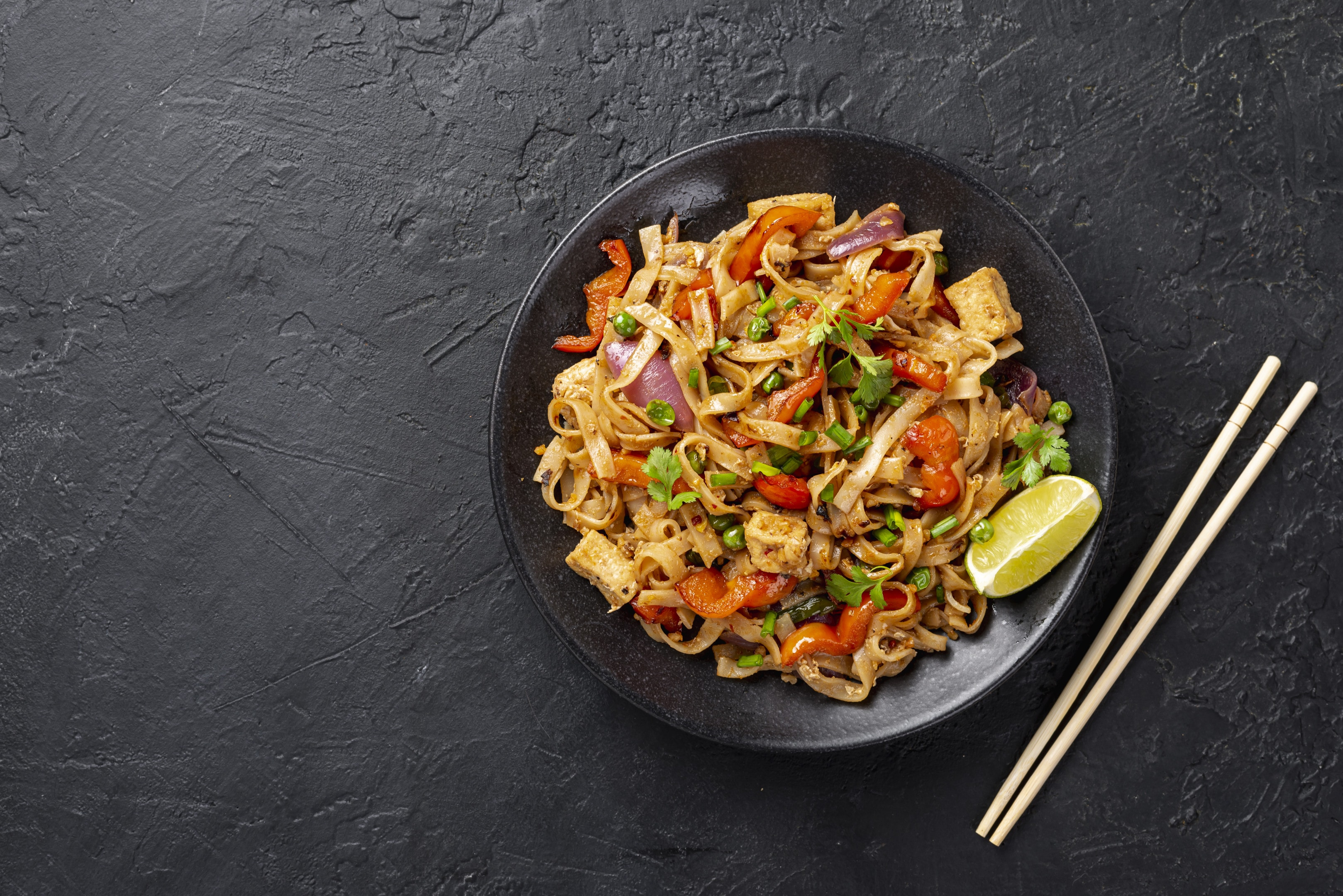 Flat lay asian noodles with vegetables and chicken