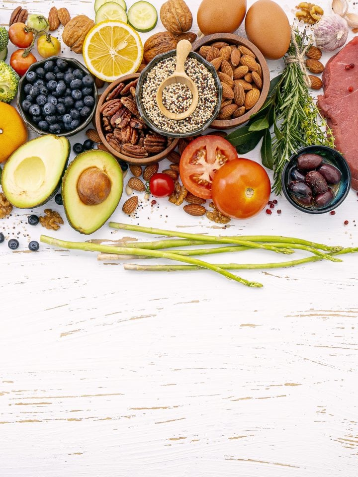 Healthy food ingredients selection on white wooden table