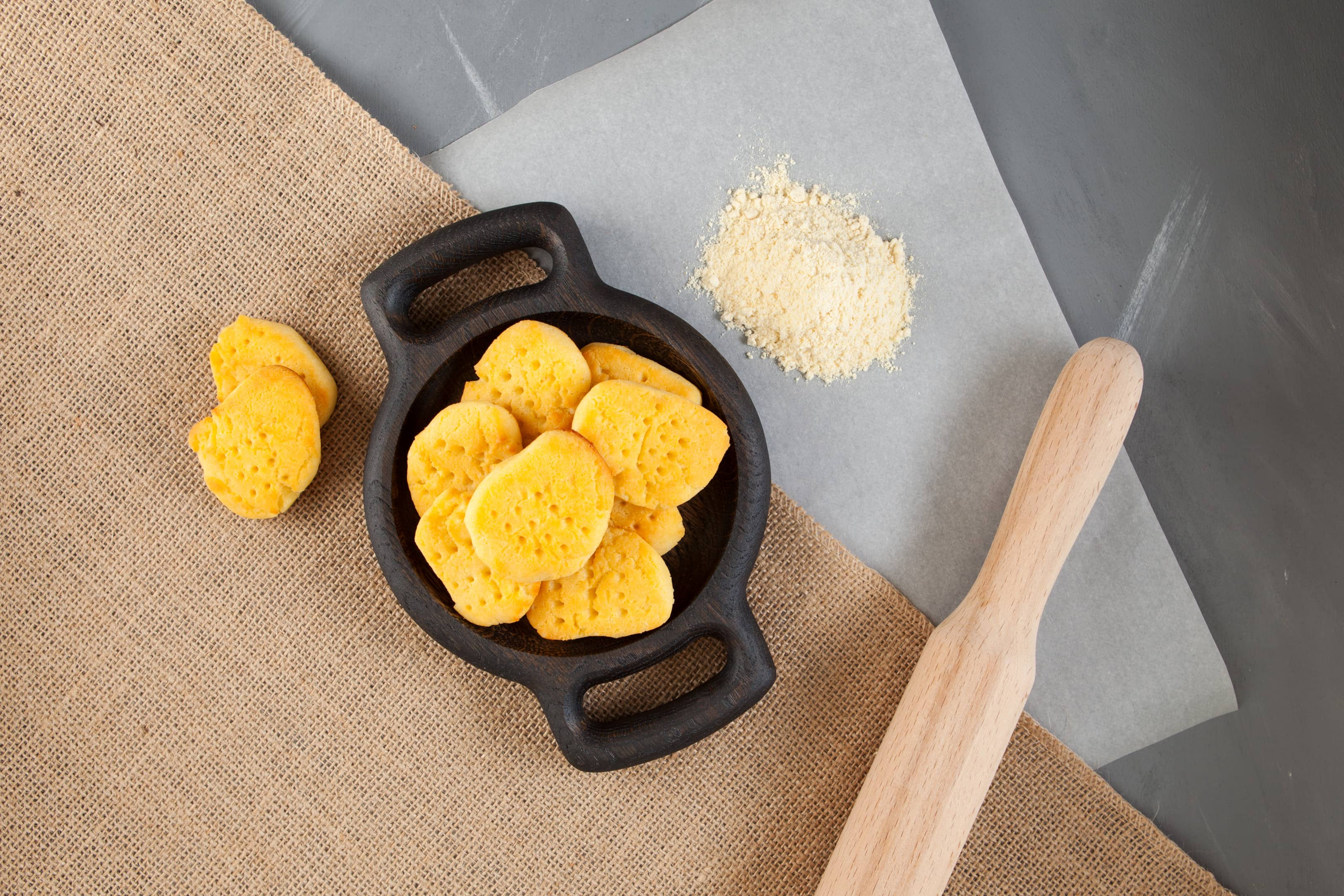 Chickpea Flour Biscuits - Vegan and Gluten-Free. Flour on baking paper and rolling