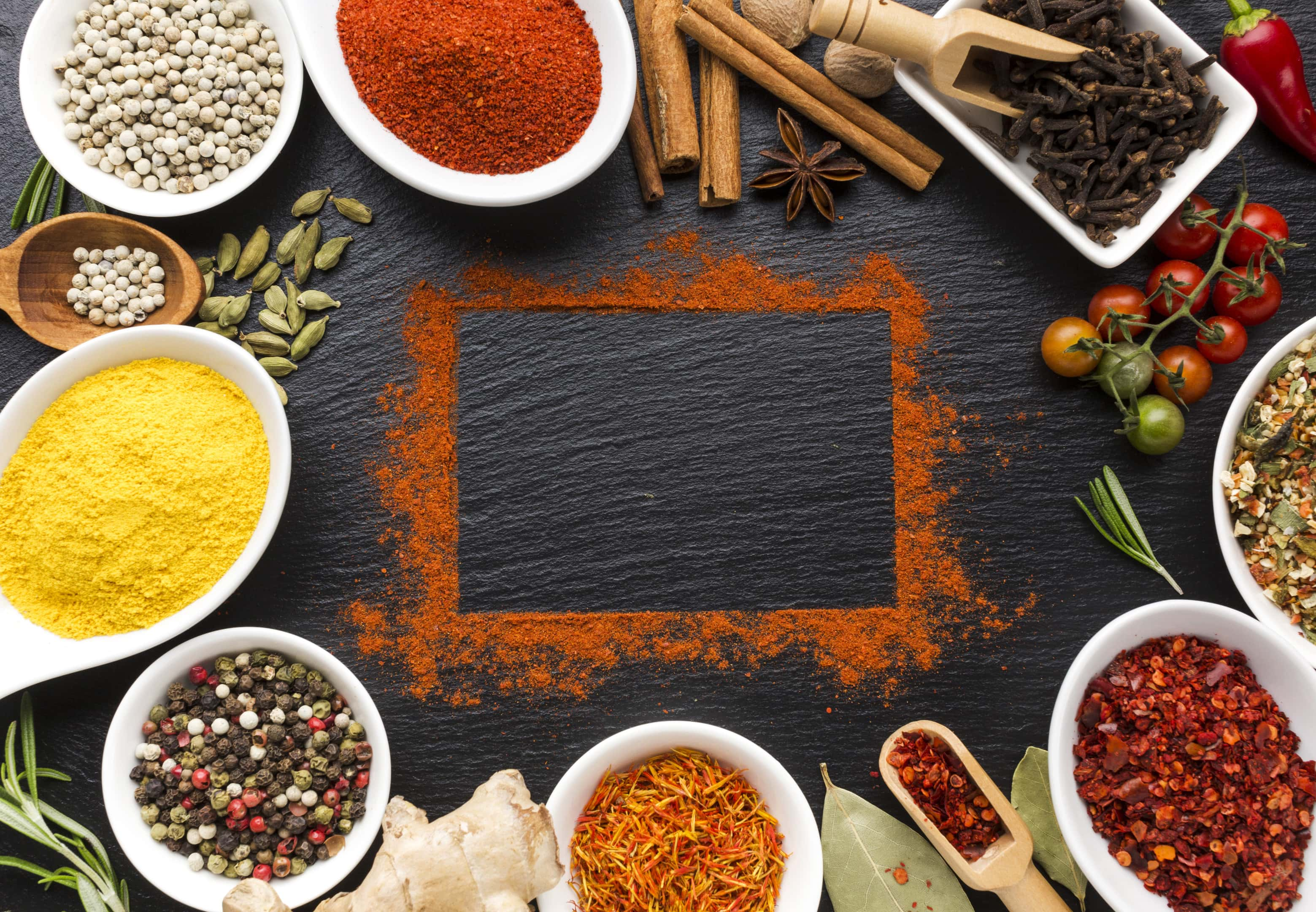 Mixture of spices and powder of spice mixture on table