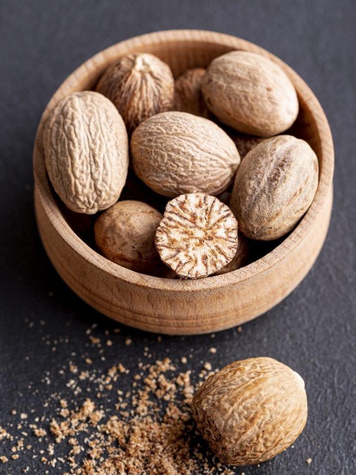 Nutmeg in wooden bowl