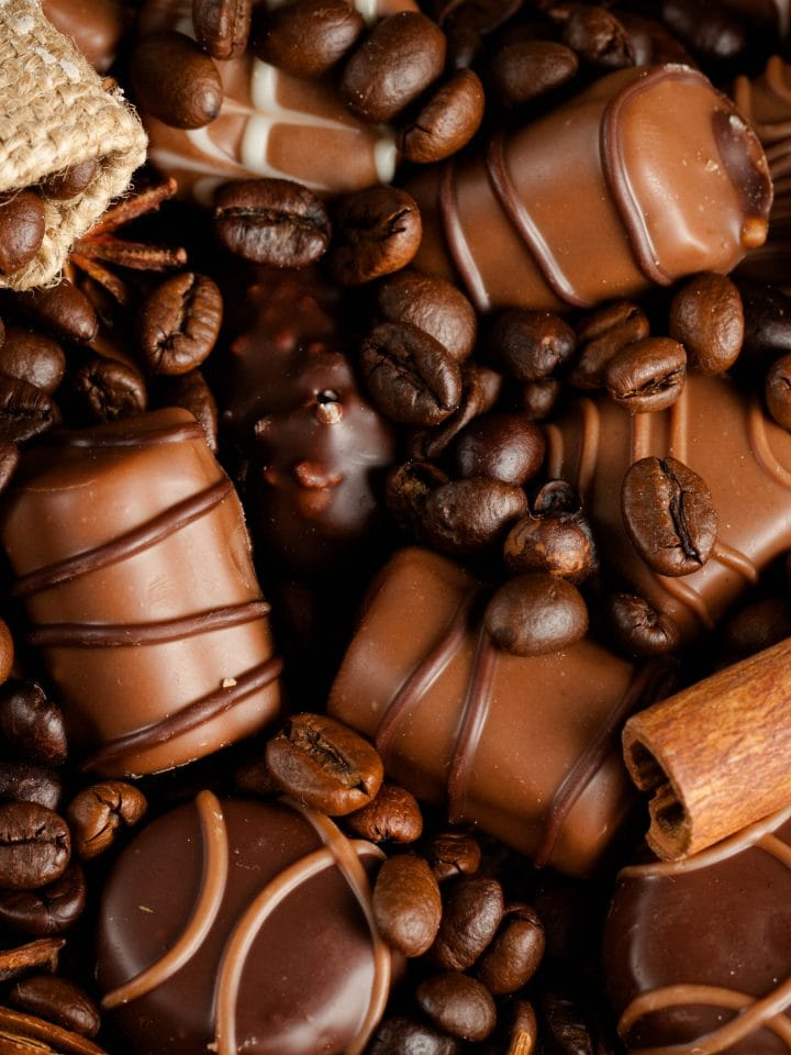 Assortment of white, dark, and milk chocolate with coffee beans.