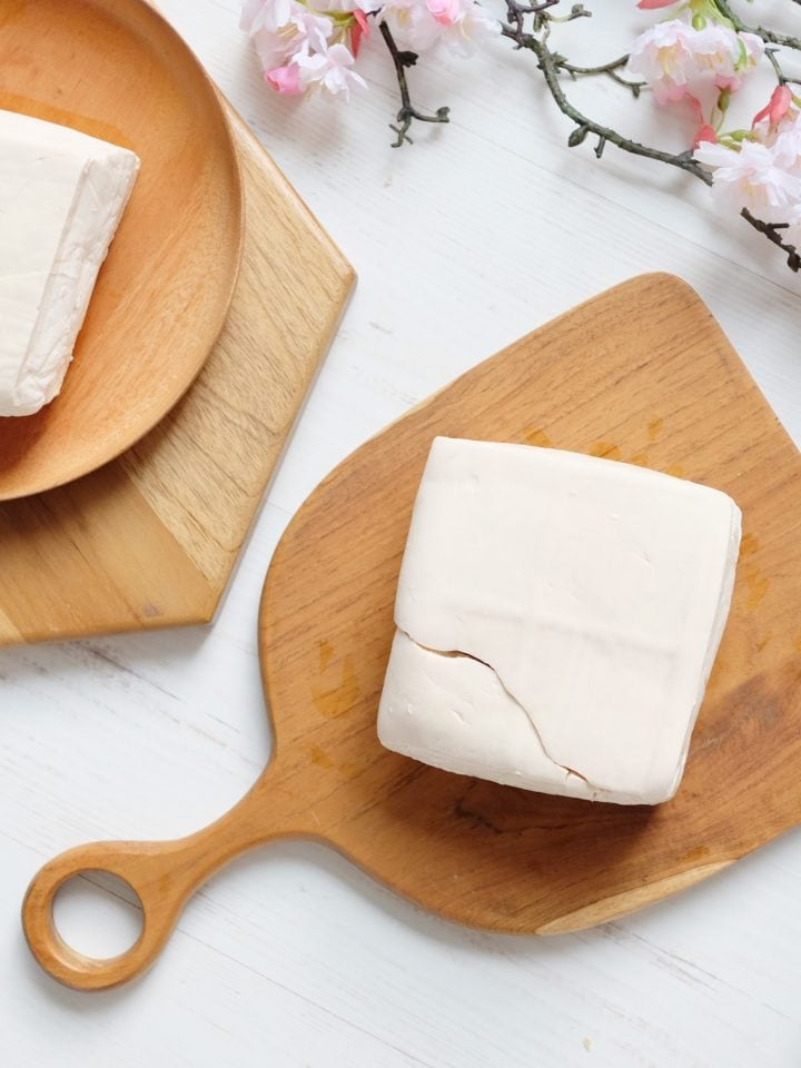 White raw tofu on wooden board