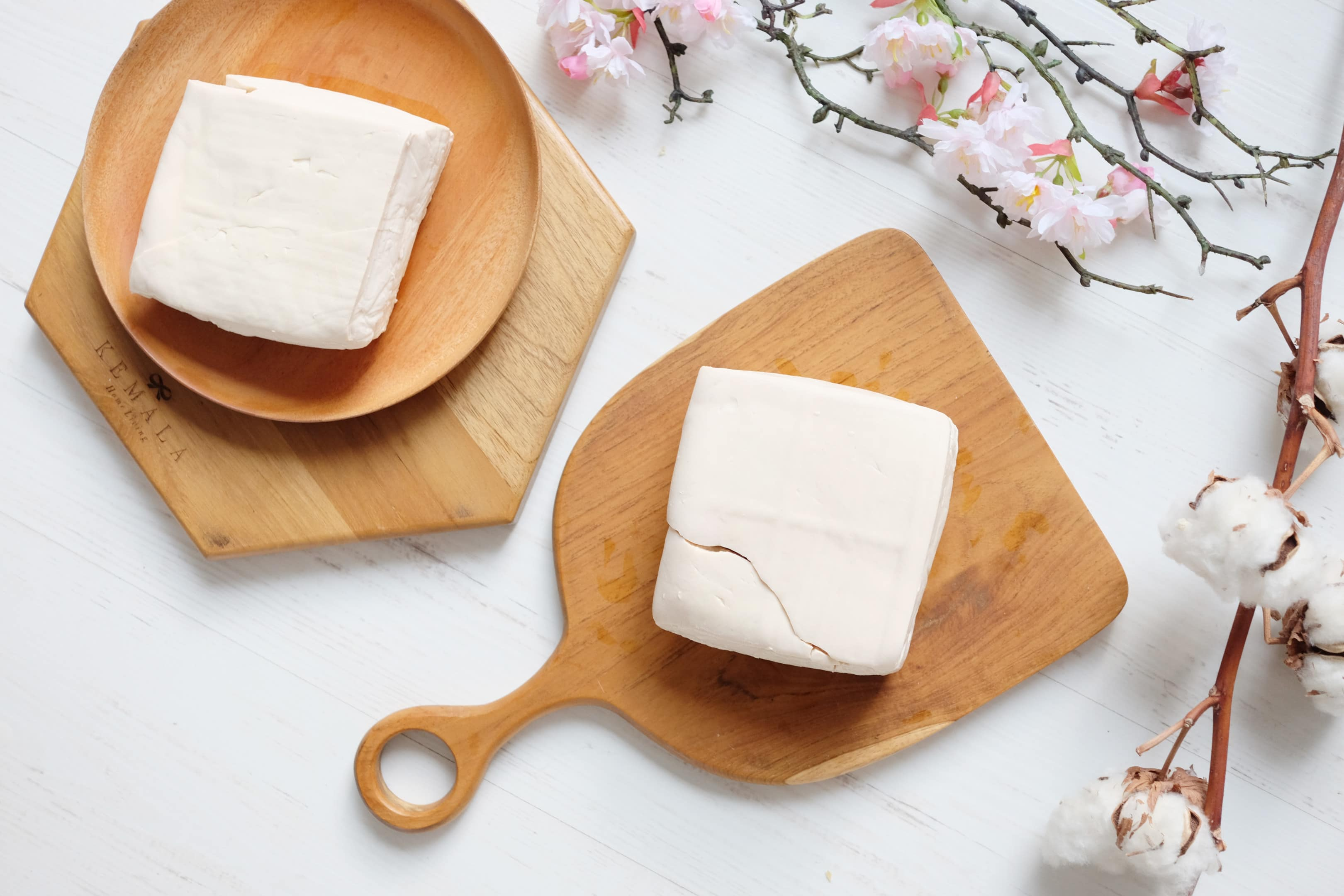 White raw tofu on wooden board