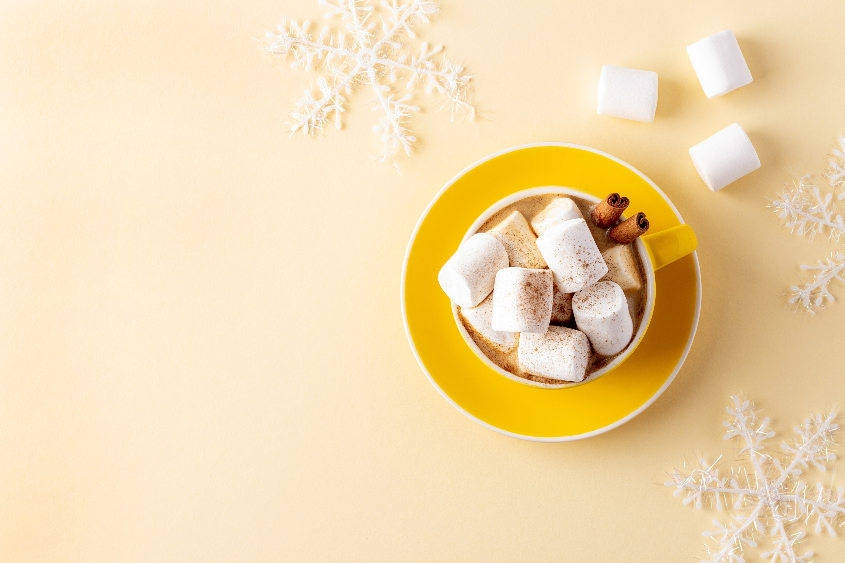 Yellow mug hot chocolate with marshmallows