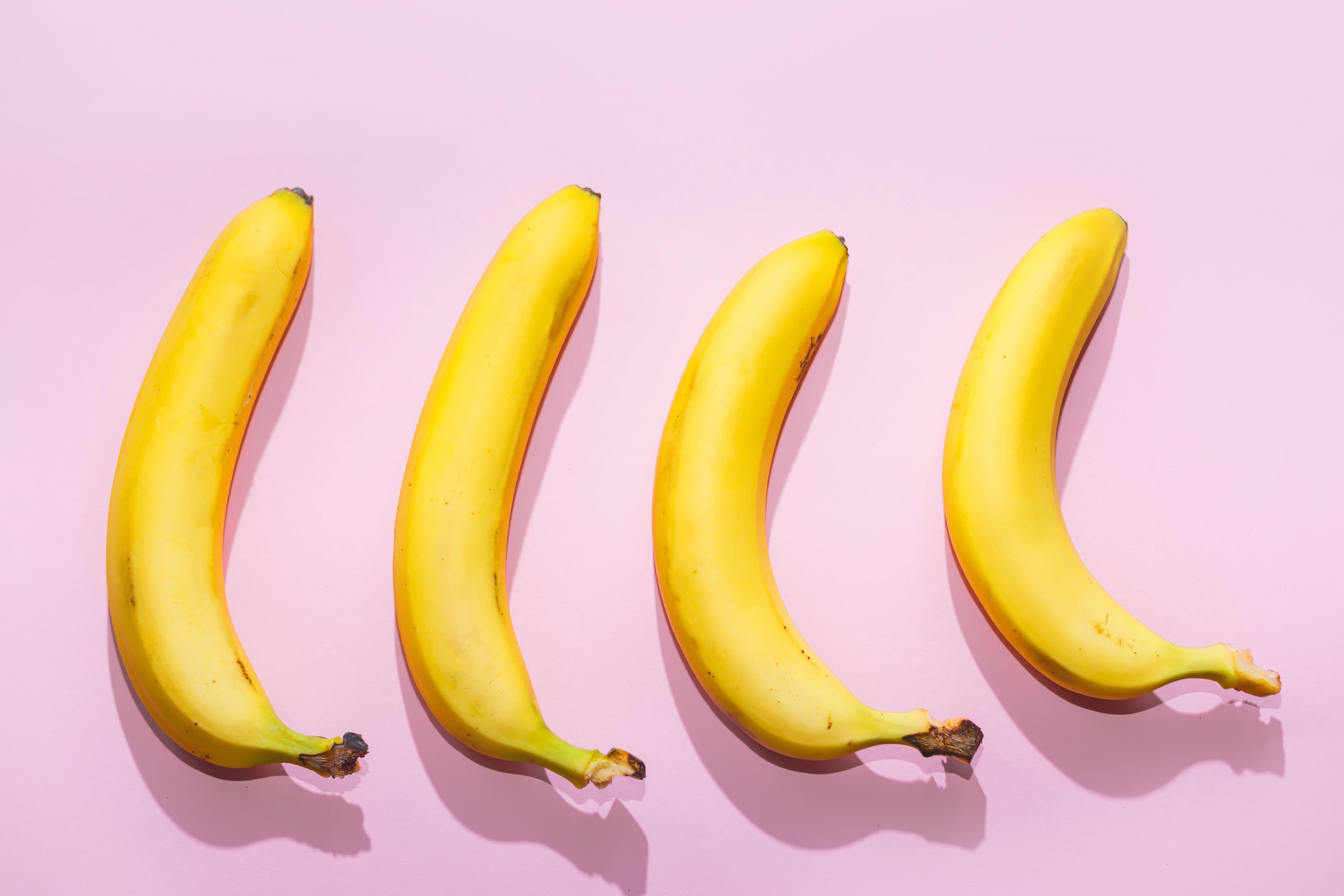 Bananas on pink pastel background