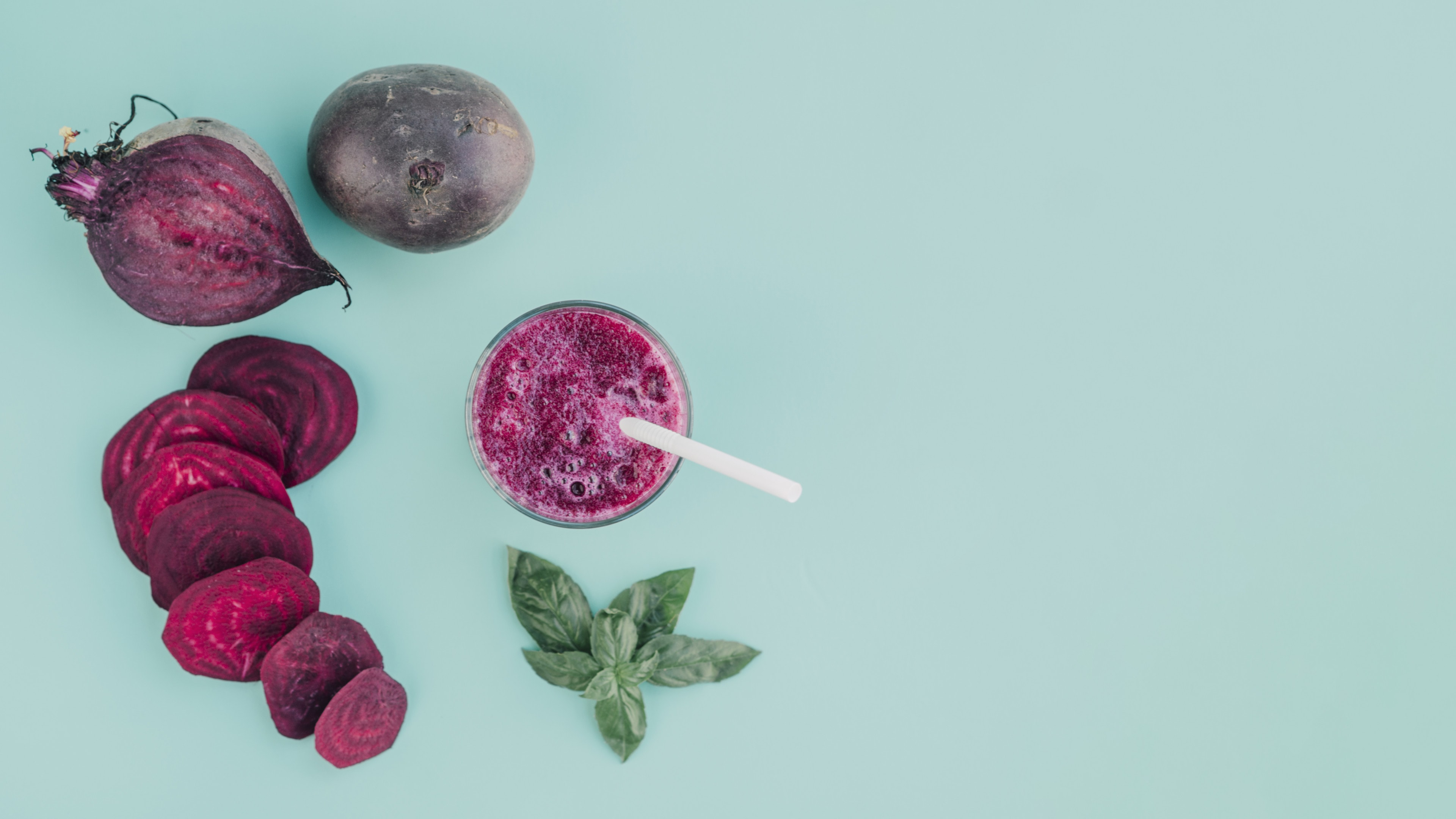 Beetroot slices and beetroot juice on gray table