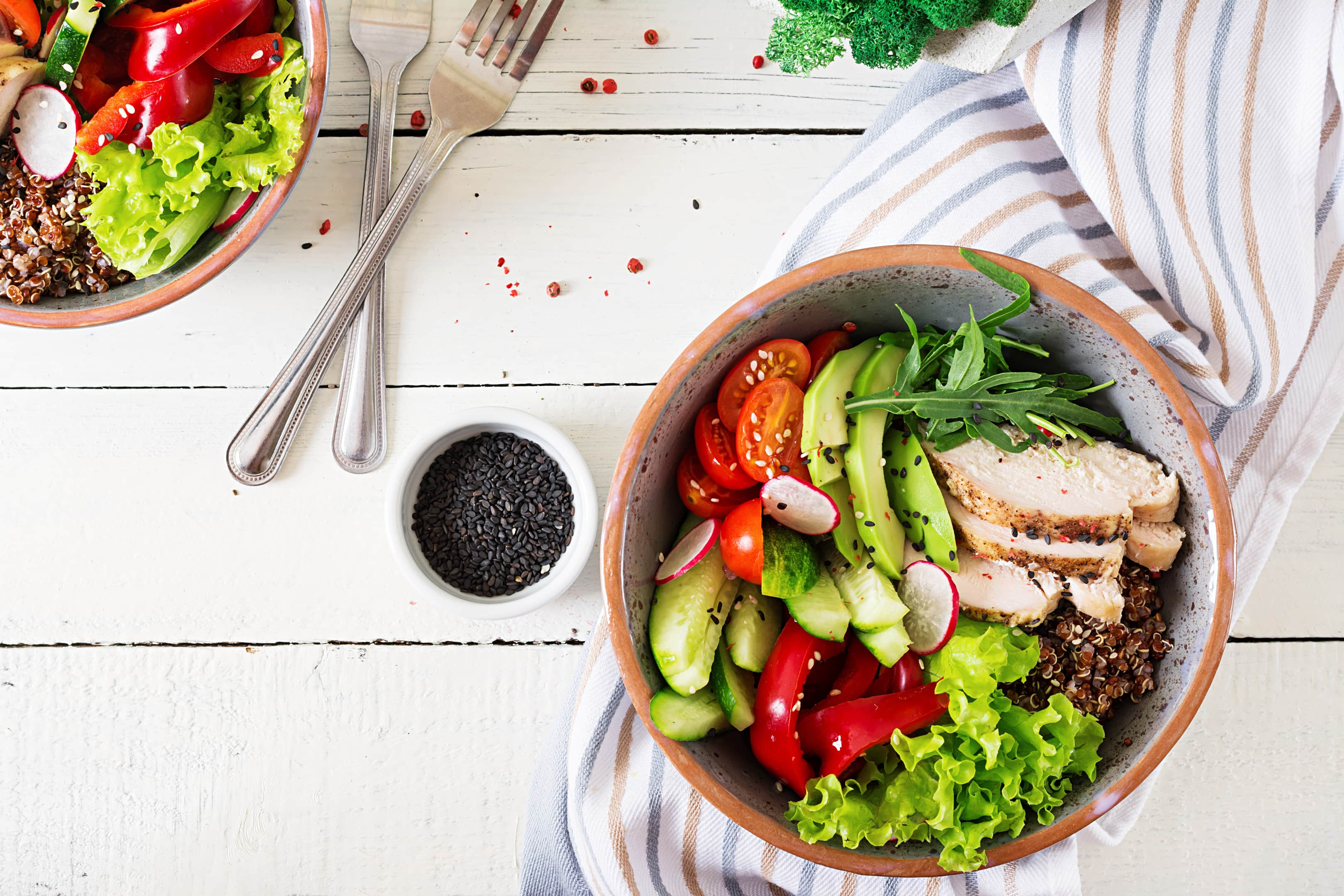 Buddha bowl dish with chicken fillet and quinoa