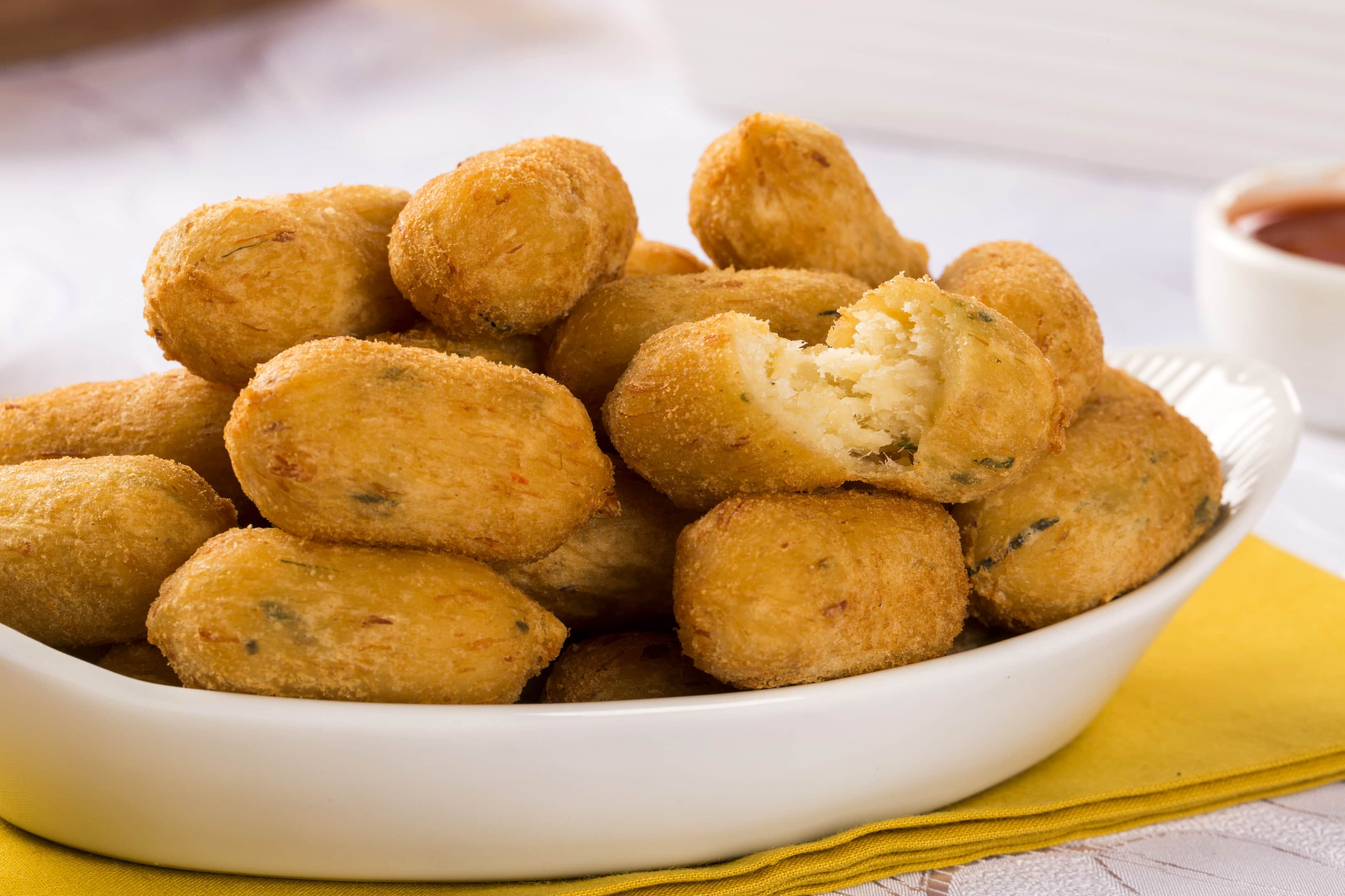 Caribbean conch fritters in white plate