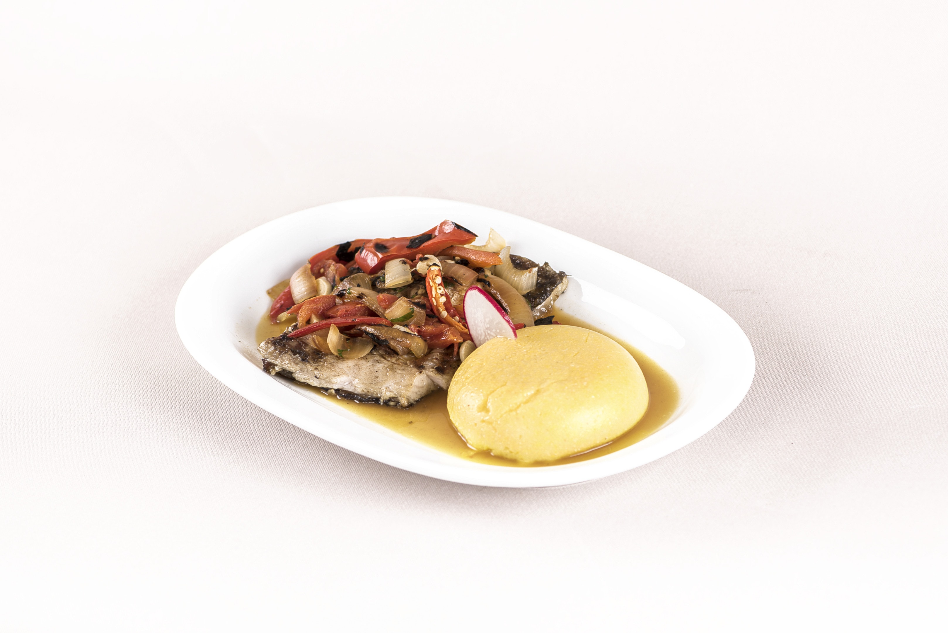 Caribbean coucou and flying fish on white plate