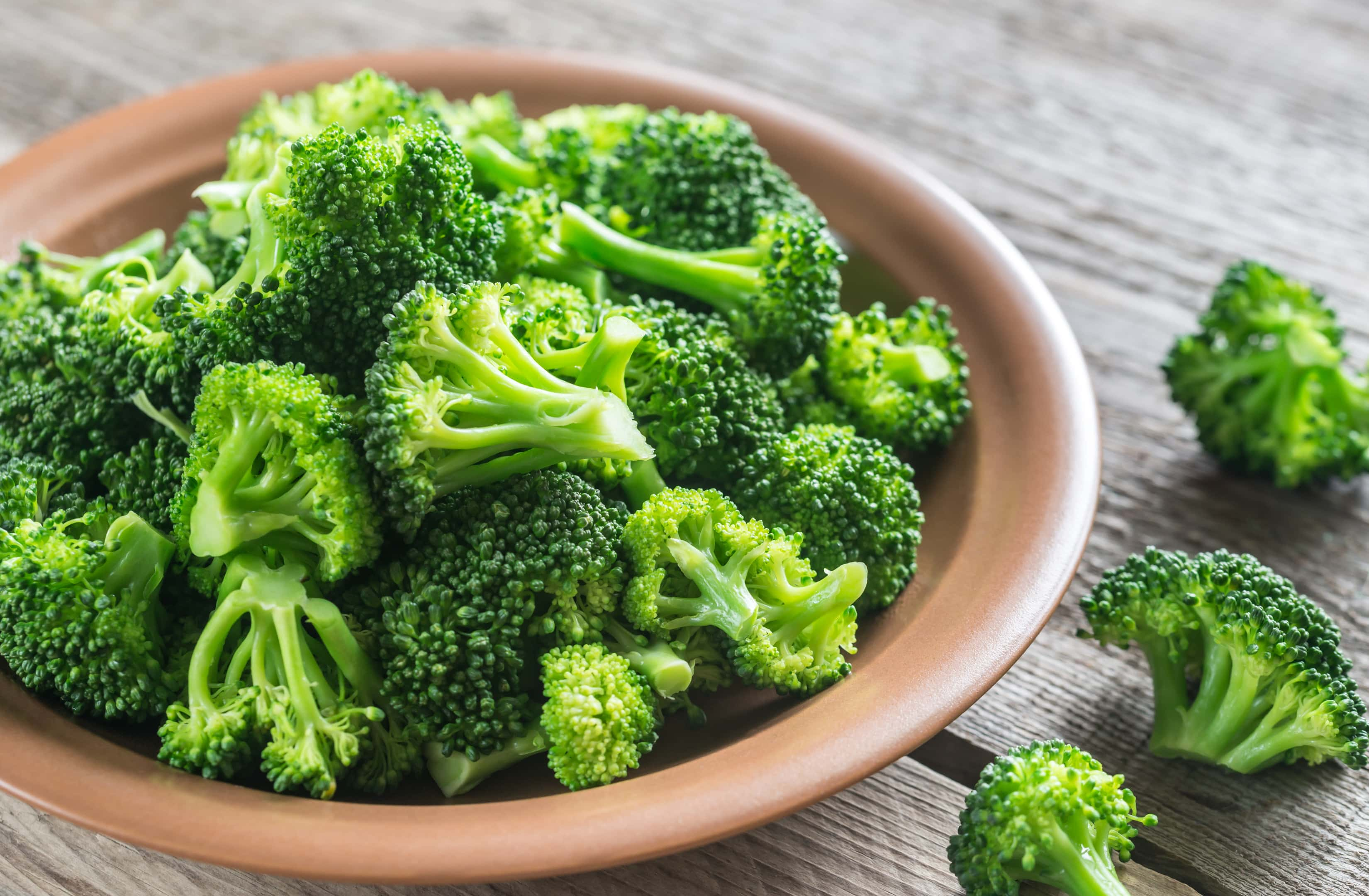 Cooked broccoli plate on wooden table