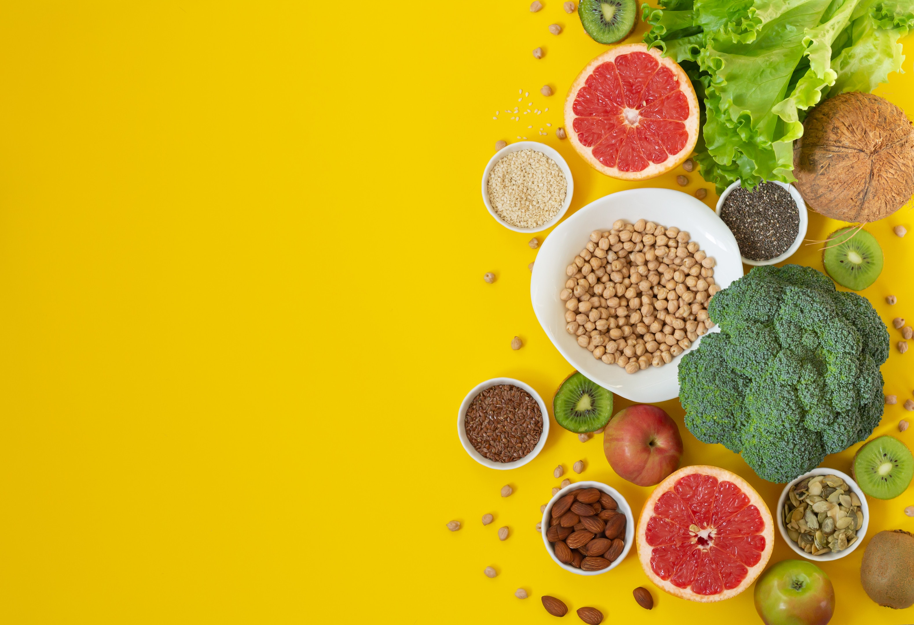 Food rich in antioxidants and fiber on yellow background