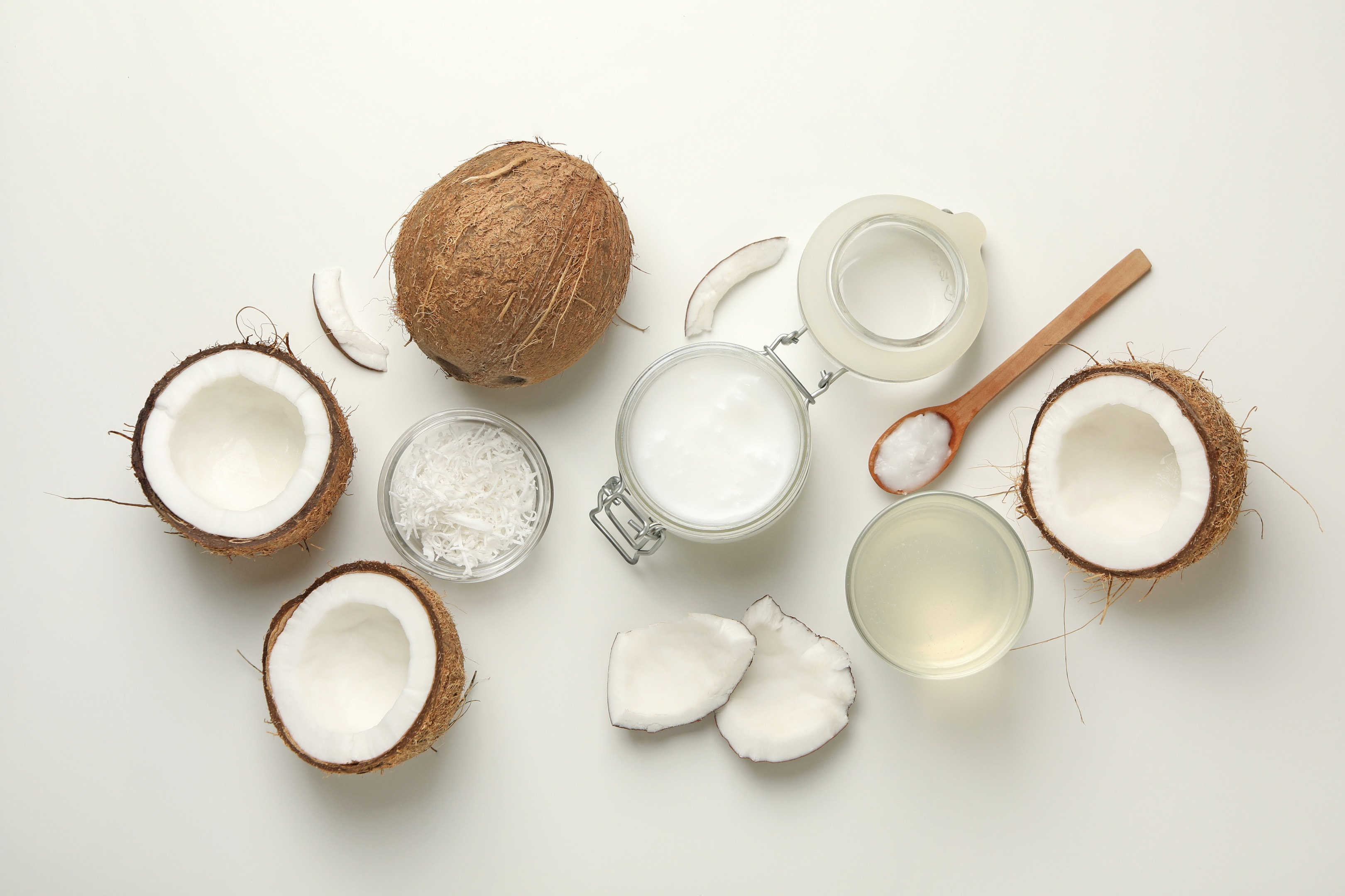 Fresh coconut and coconut water on white background