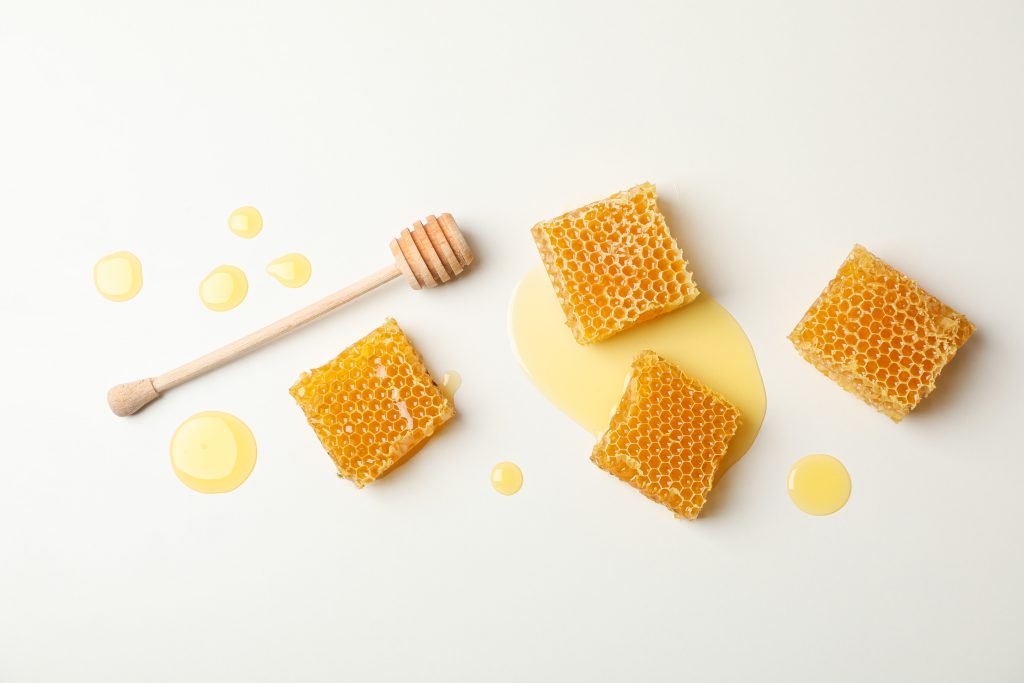 Honeycombs dipper on white background
