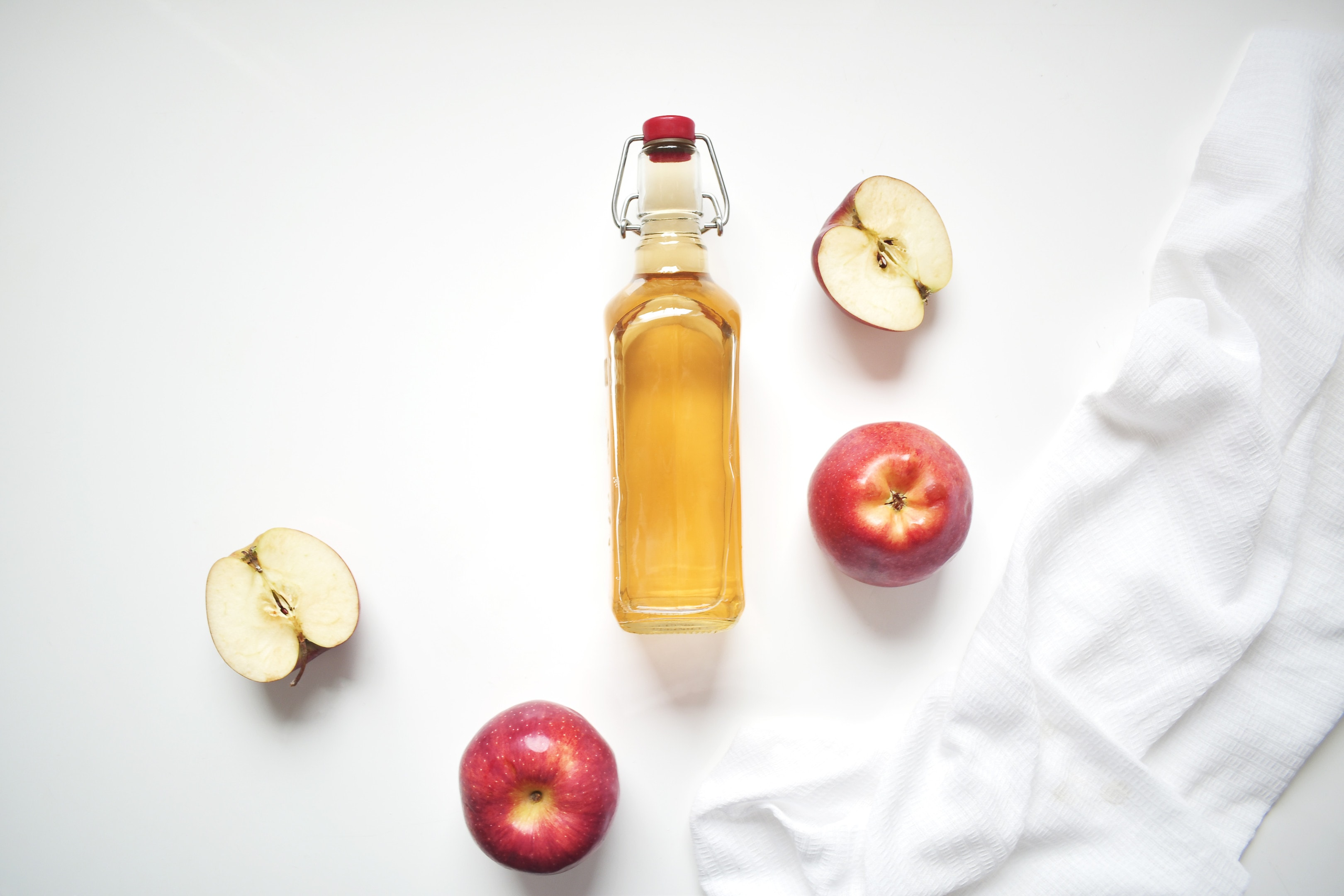 Natural apple cider vinegar on white background