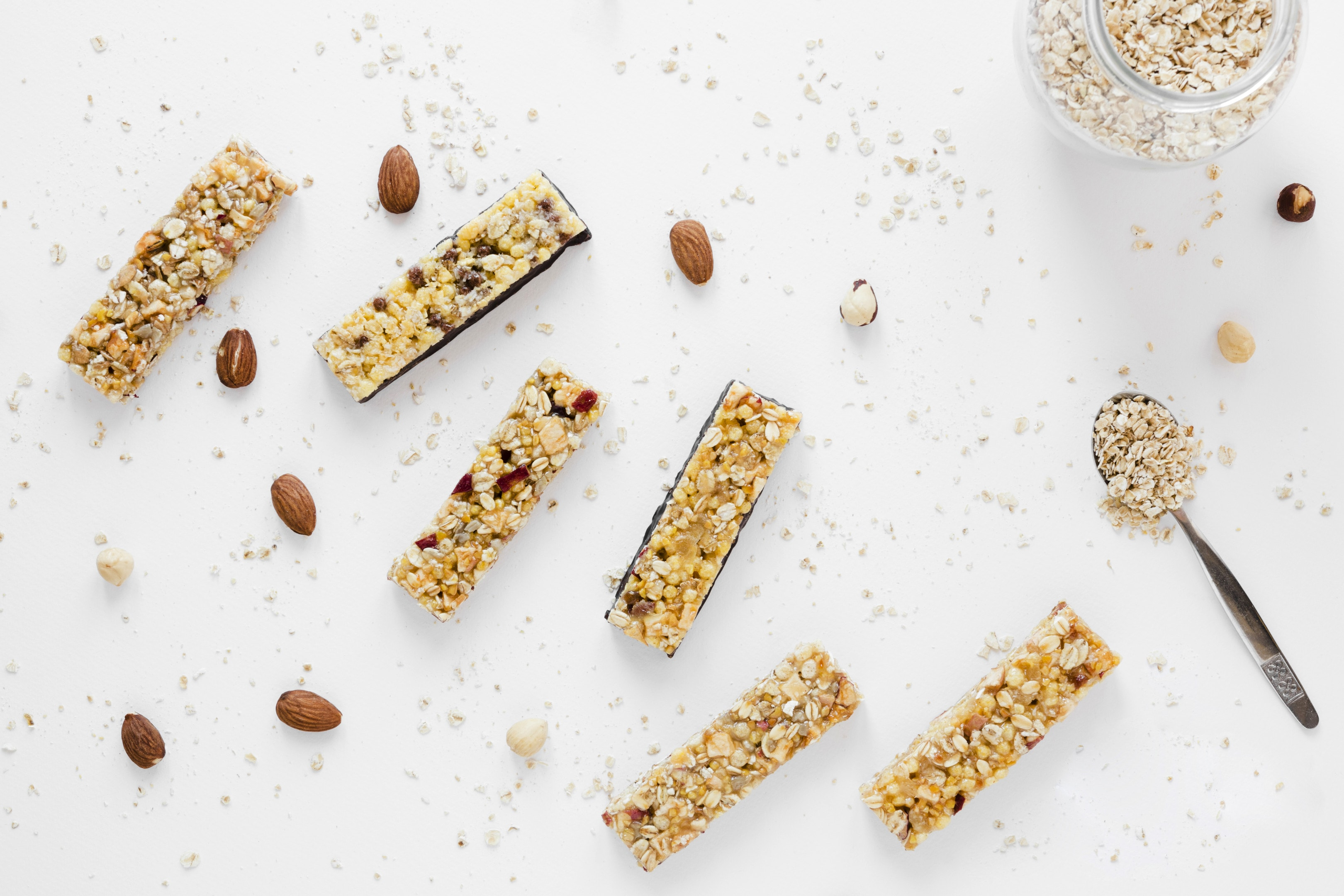 Protein bars with oats nuts on white table