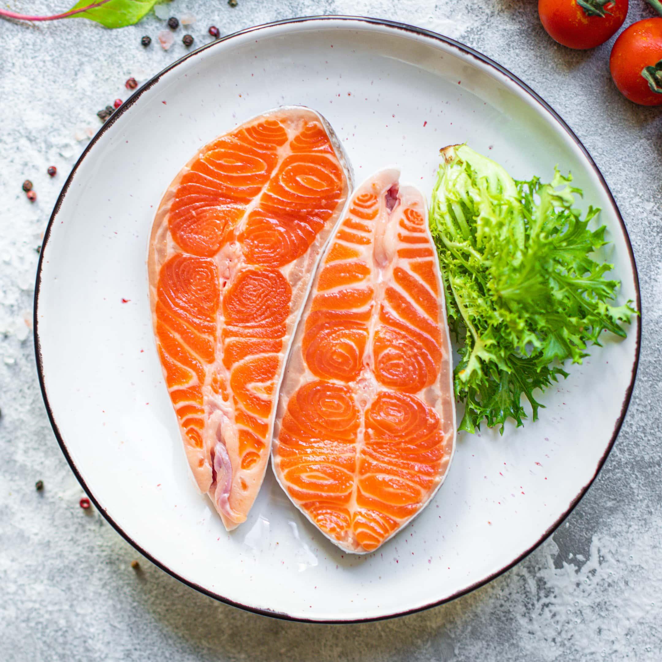 Salmon fish raw steak fillet on ceramic plate