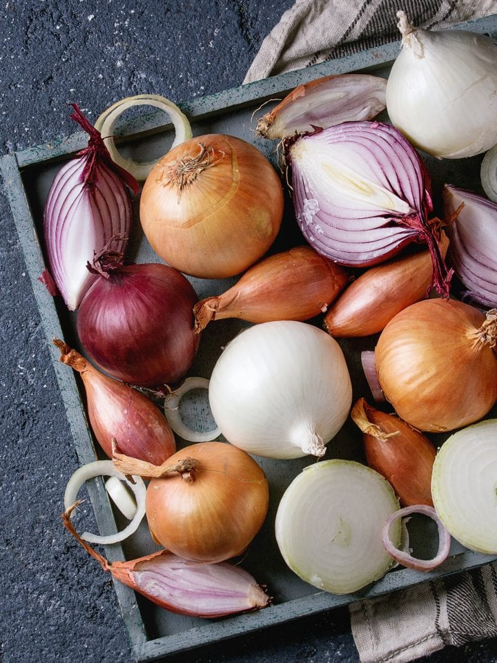 Variety of whole and sliced onion and shallots