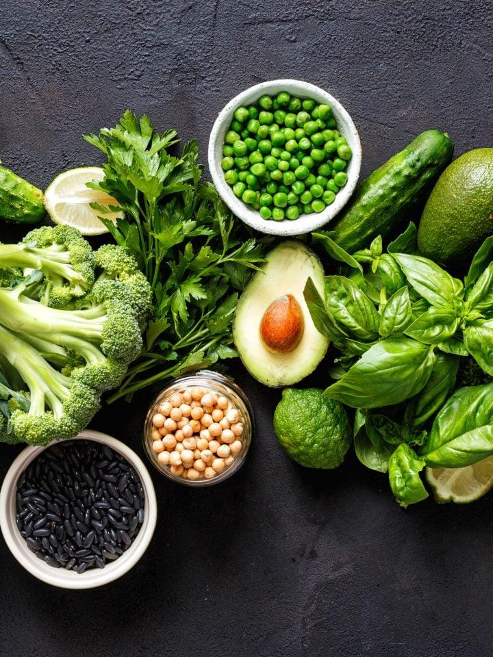 Various leafy green vegetables on dark background