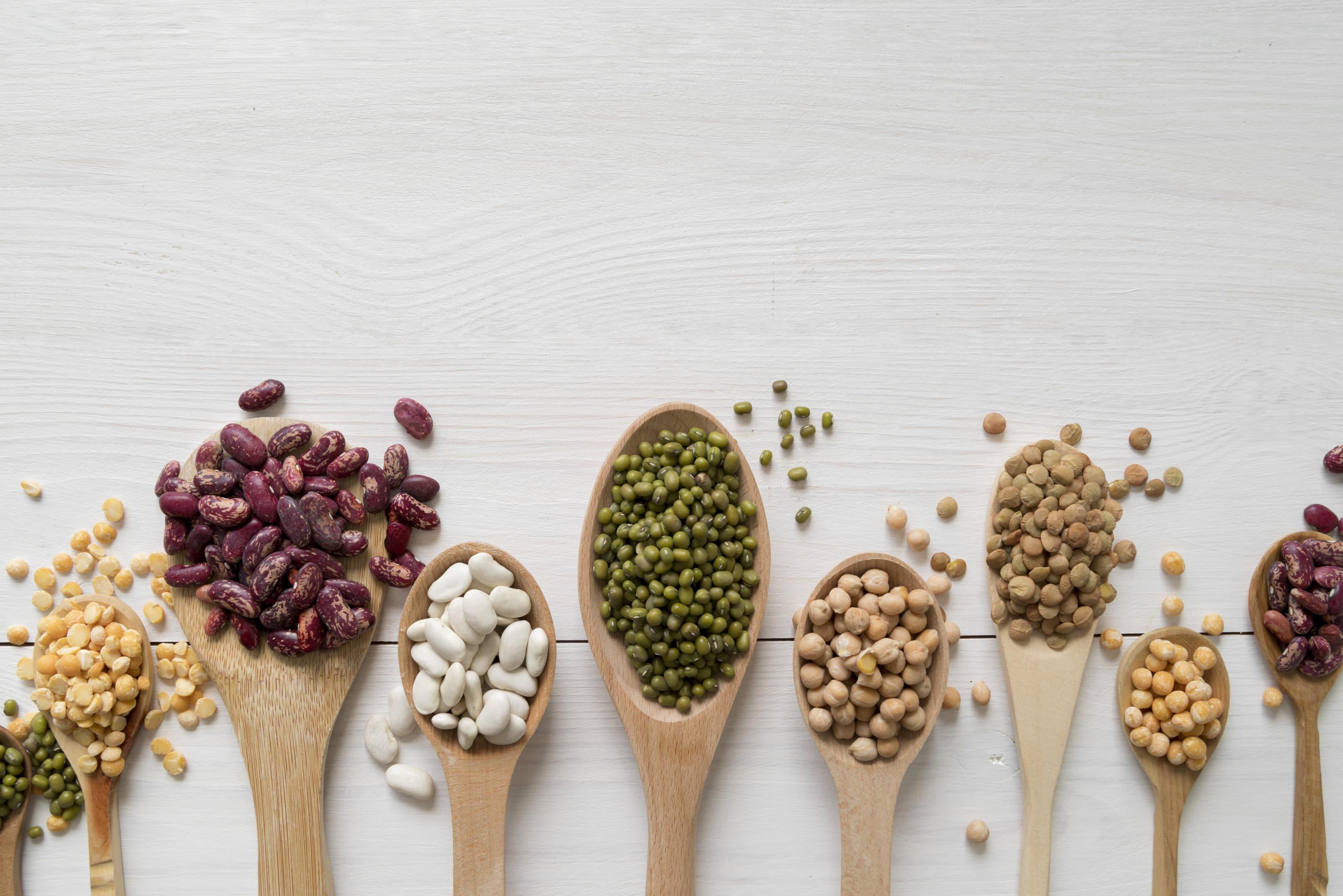 Beans arrangement on wooden table