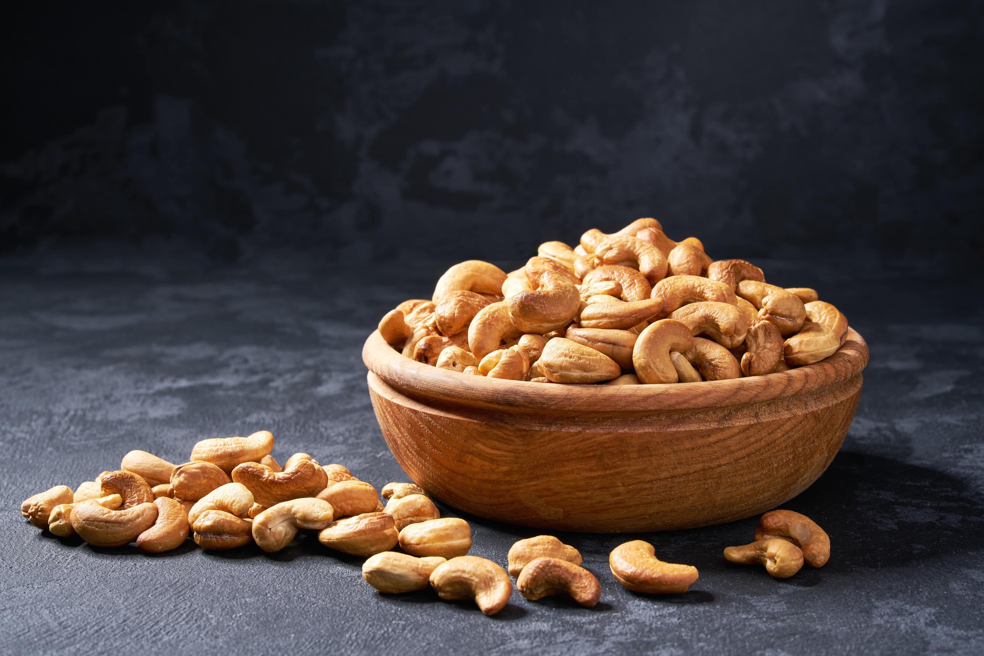 Cashew nuts in wooden bowl