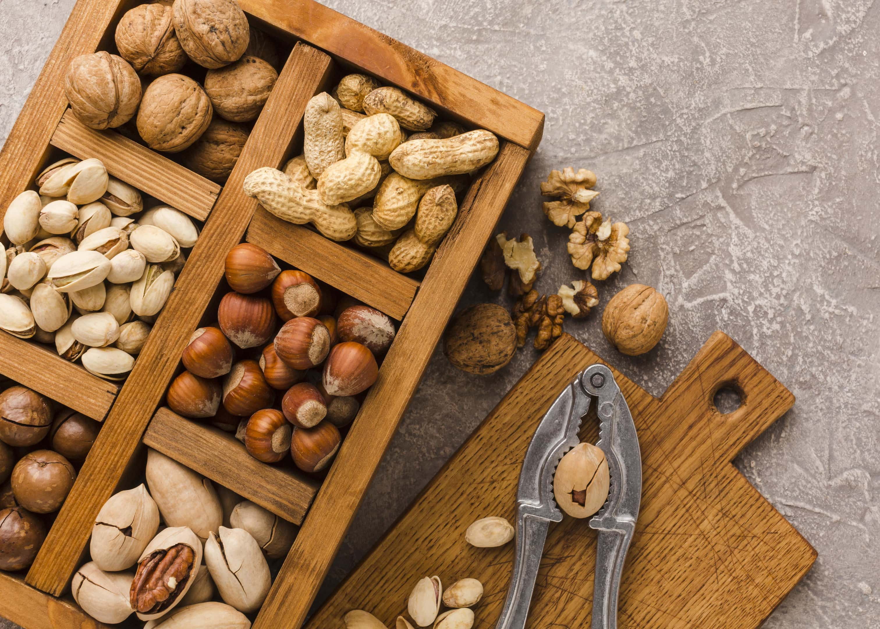 Different types nuts in wooden box