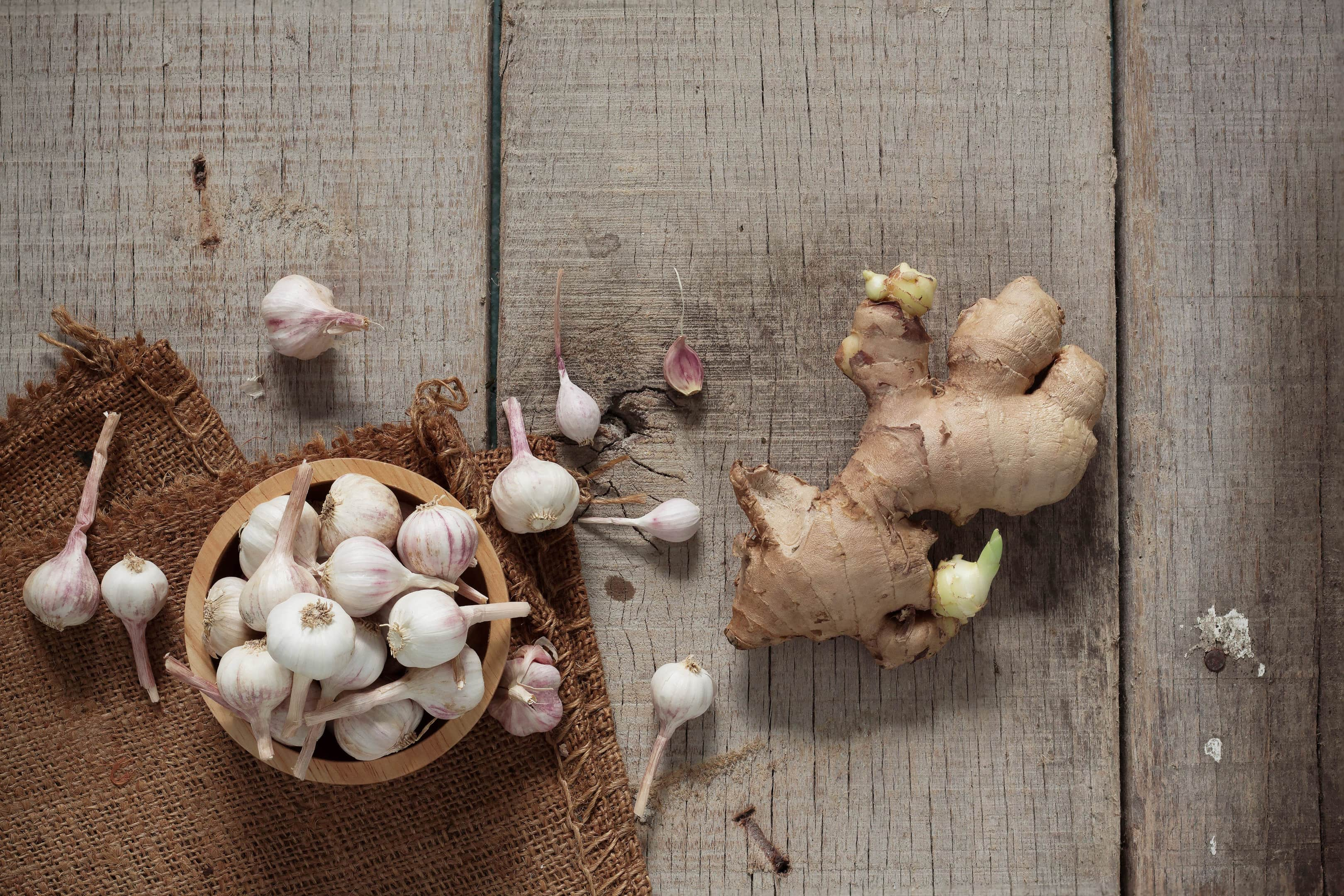 Garlic and ginger on wooden table