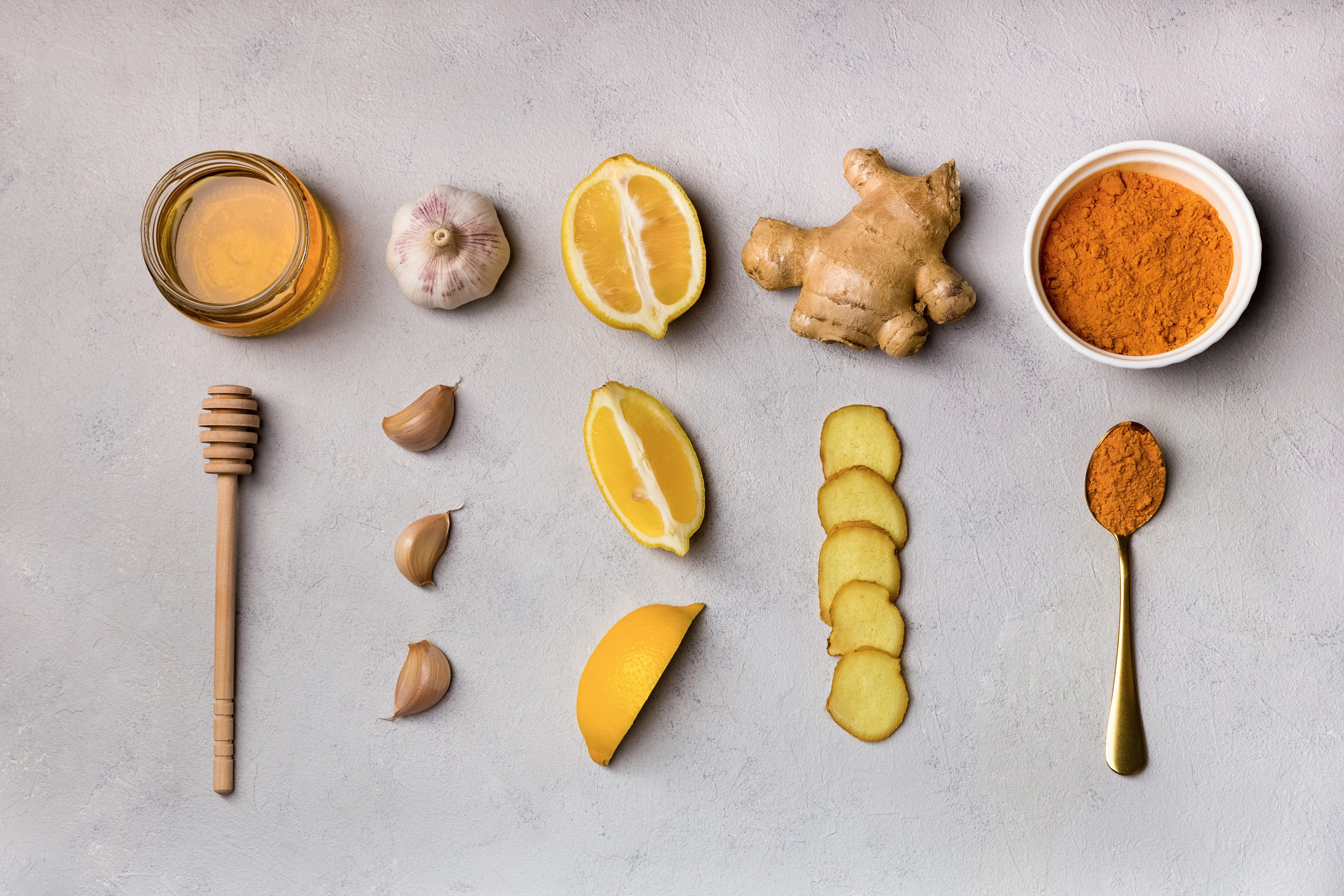 Ginger garlic turmeric honey lemon on table