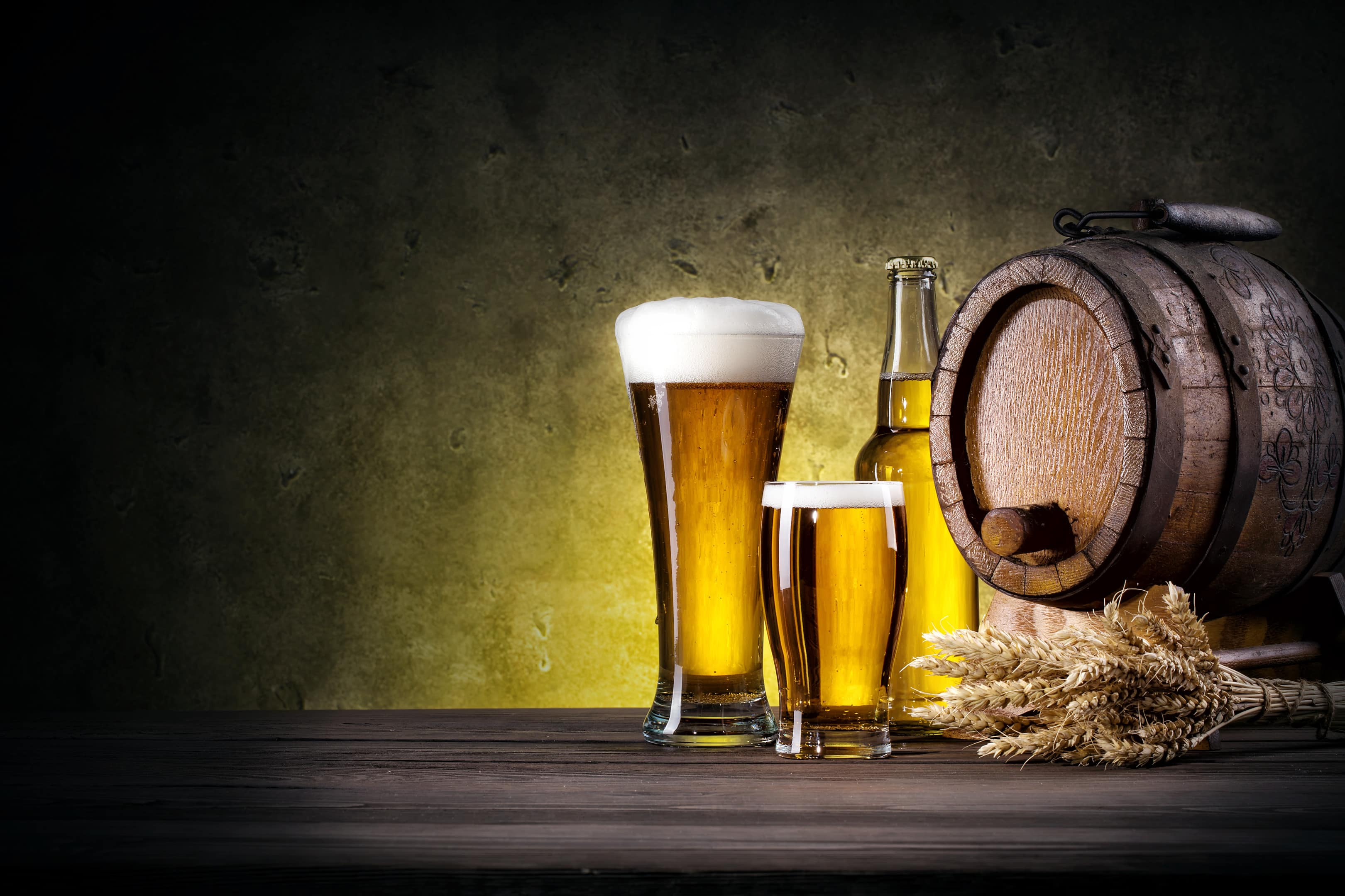 Glasses of beer with beer barrel