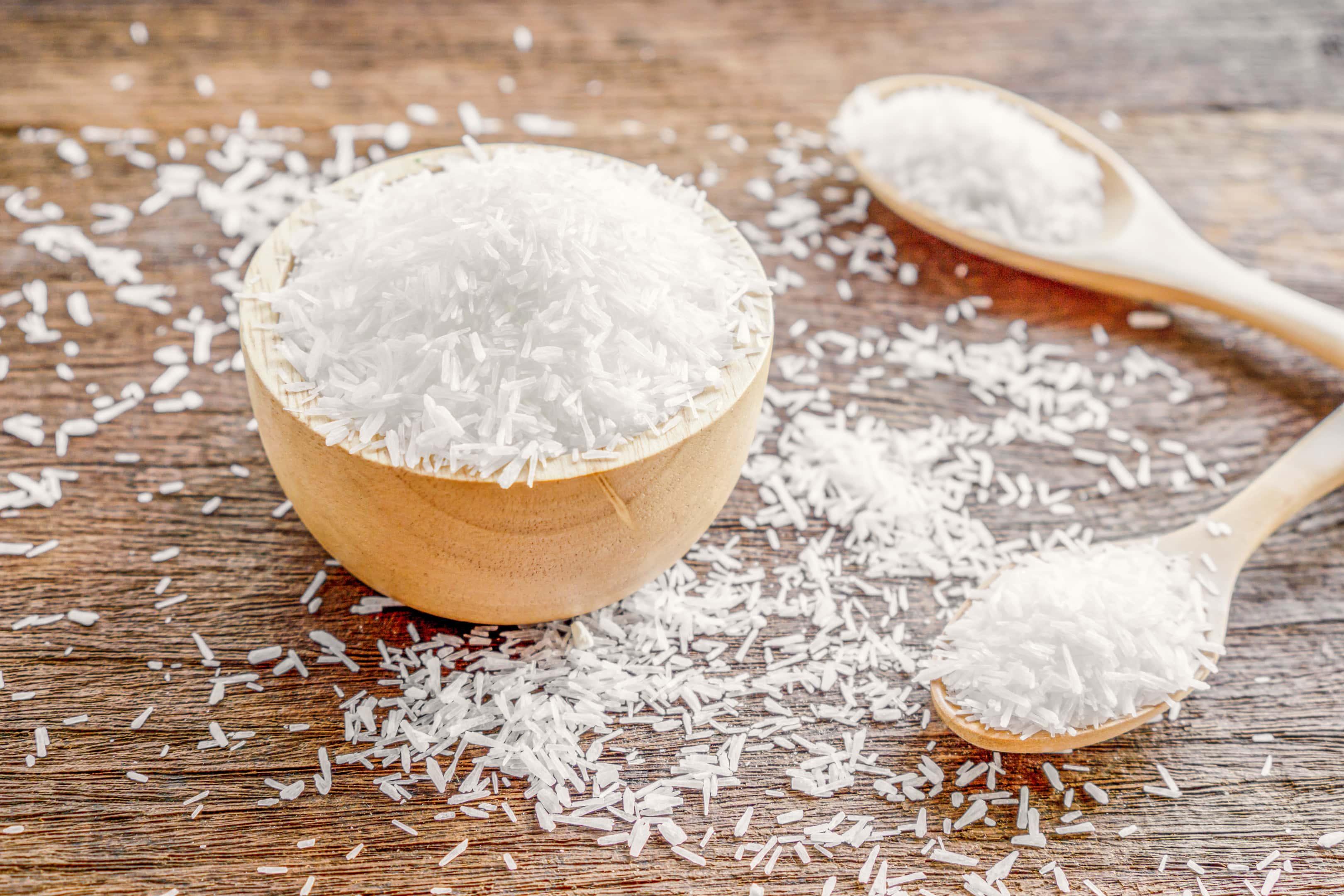 Monosodium glutamate in wooden bowl