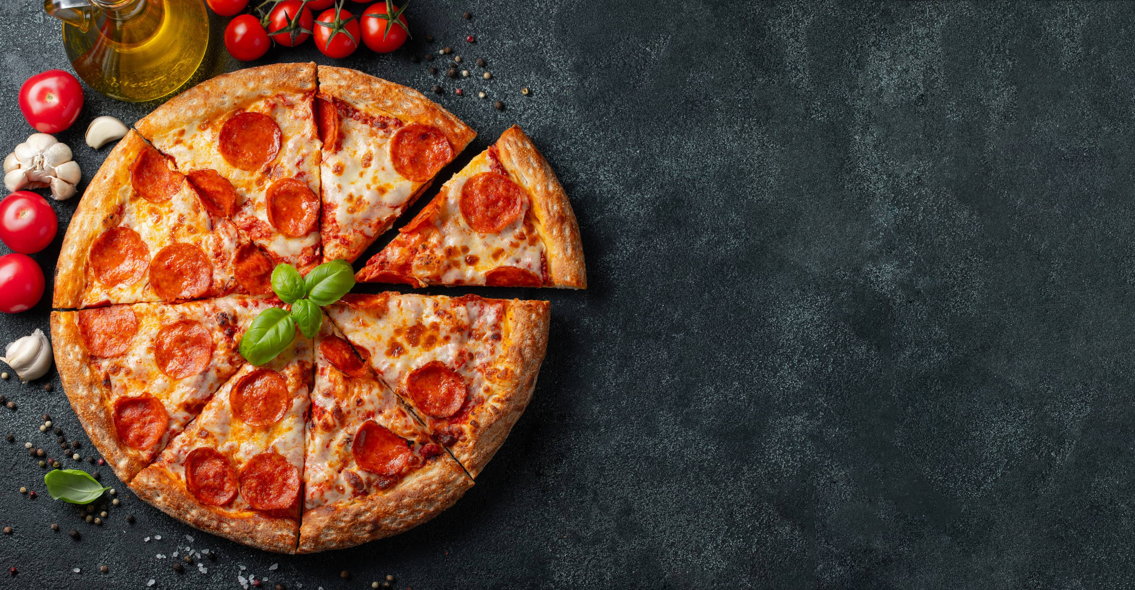 Pepperoni pizza on black background