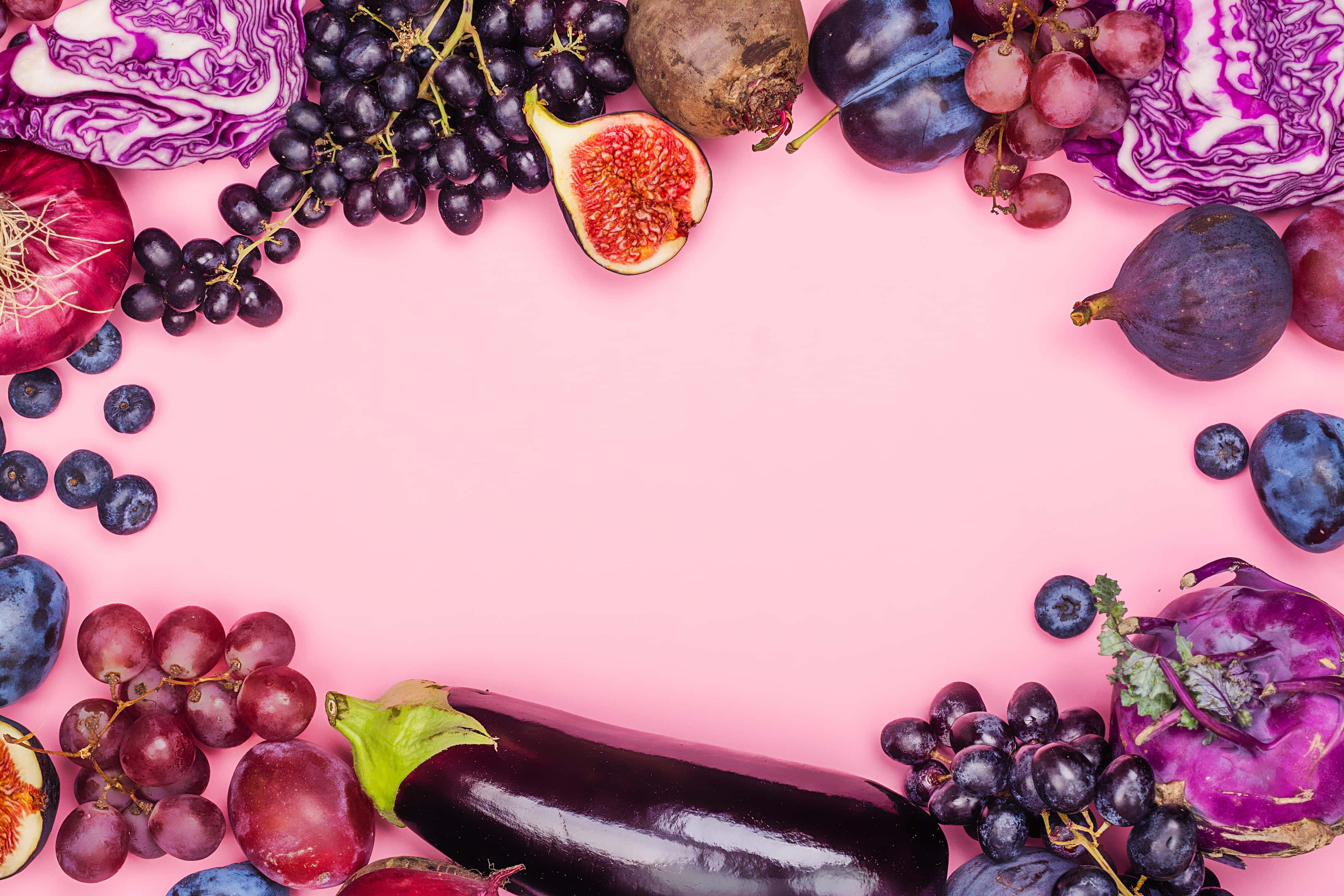Selection of purple fruit grapes plums blueberries and figs