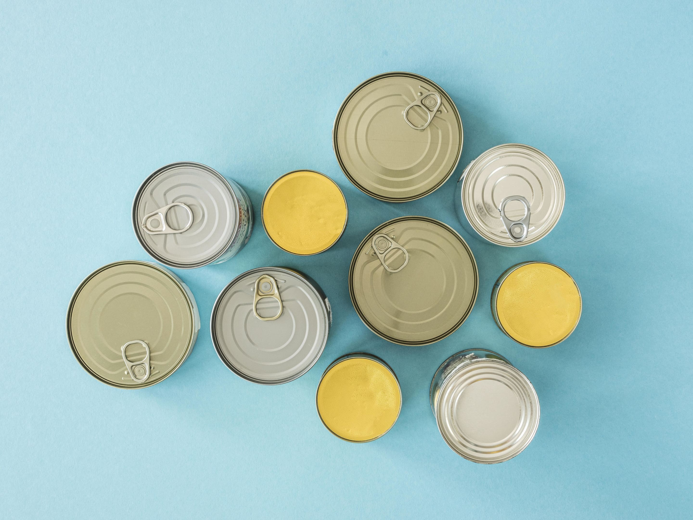 Top view of canned food on blue background