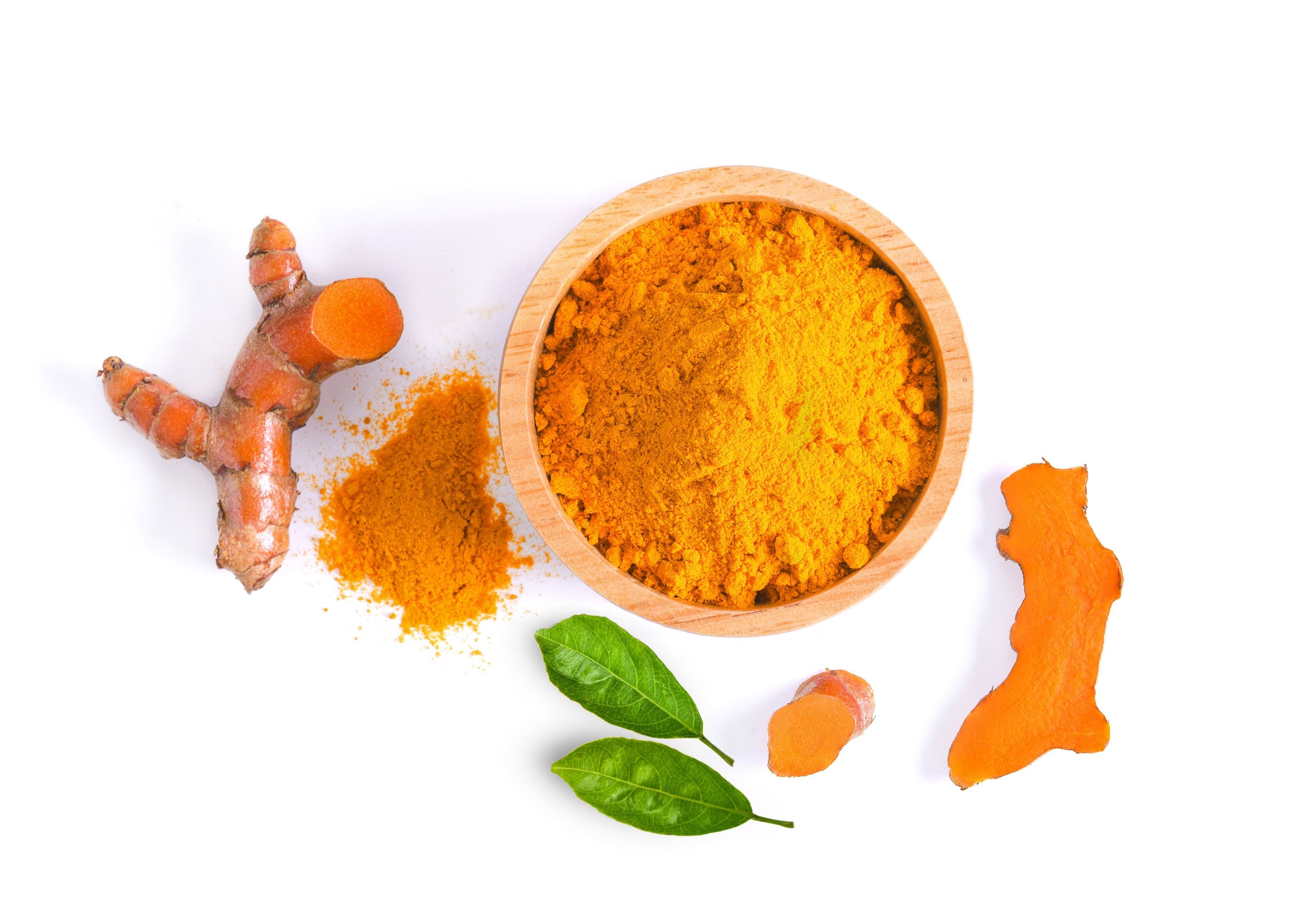 Turmeric root and powder on white background