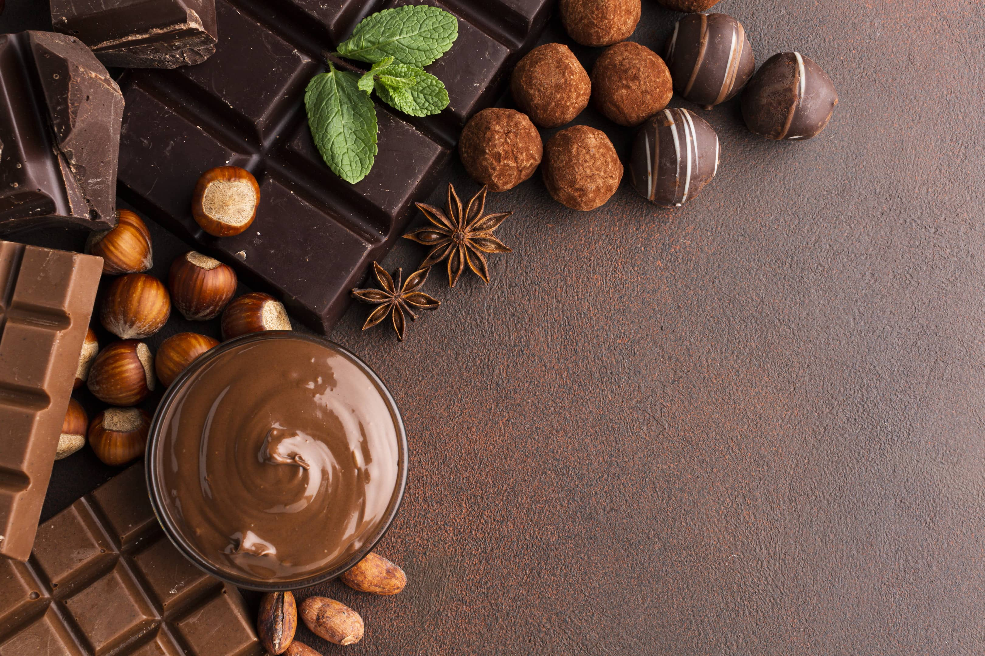 Variety of chocolate on brown surface