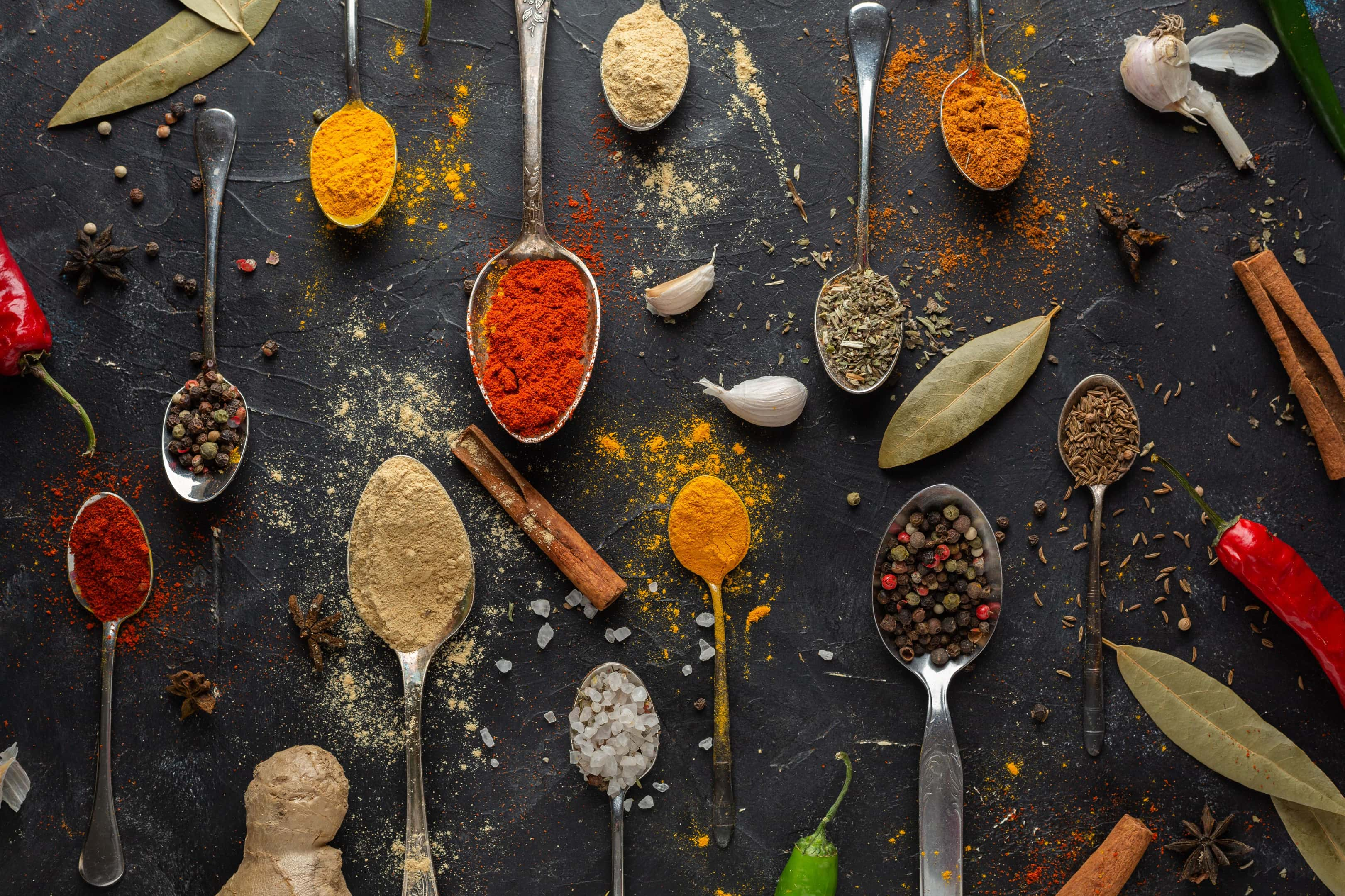 Variety of spices on black table