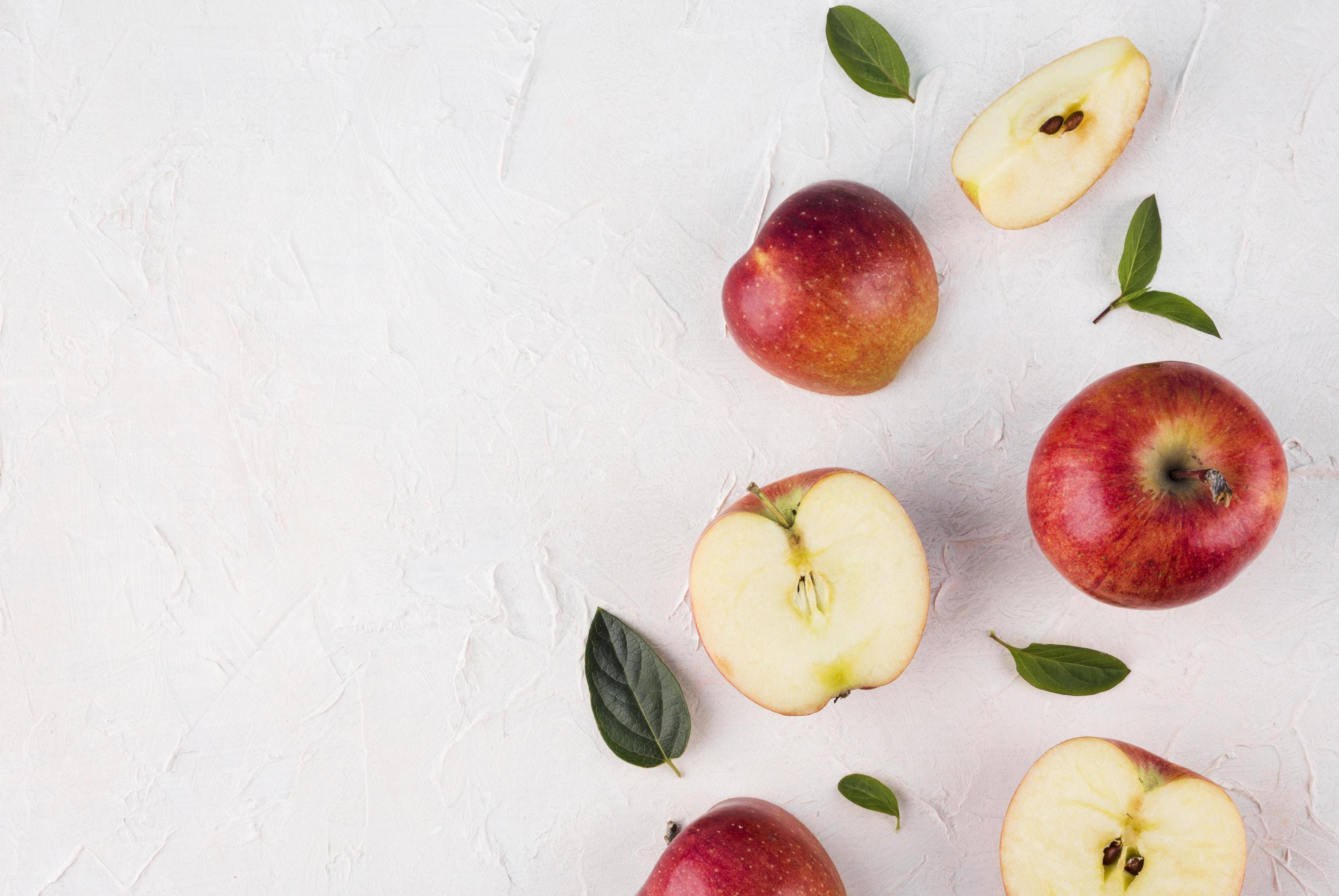 Assortment of apples on light background