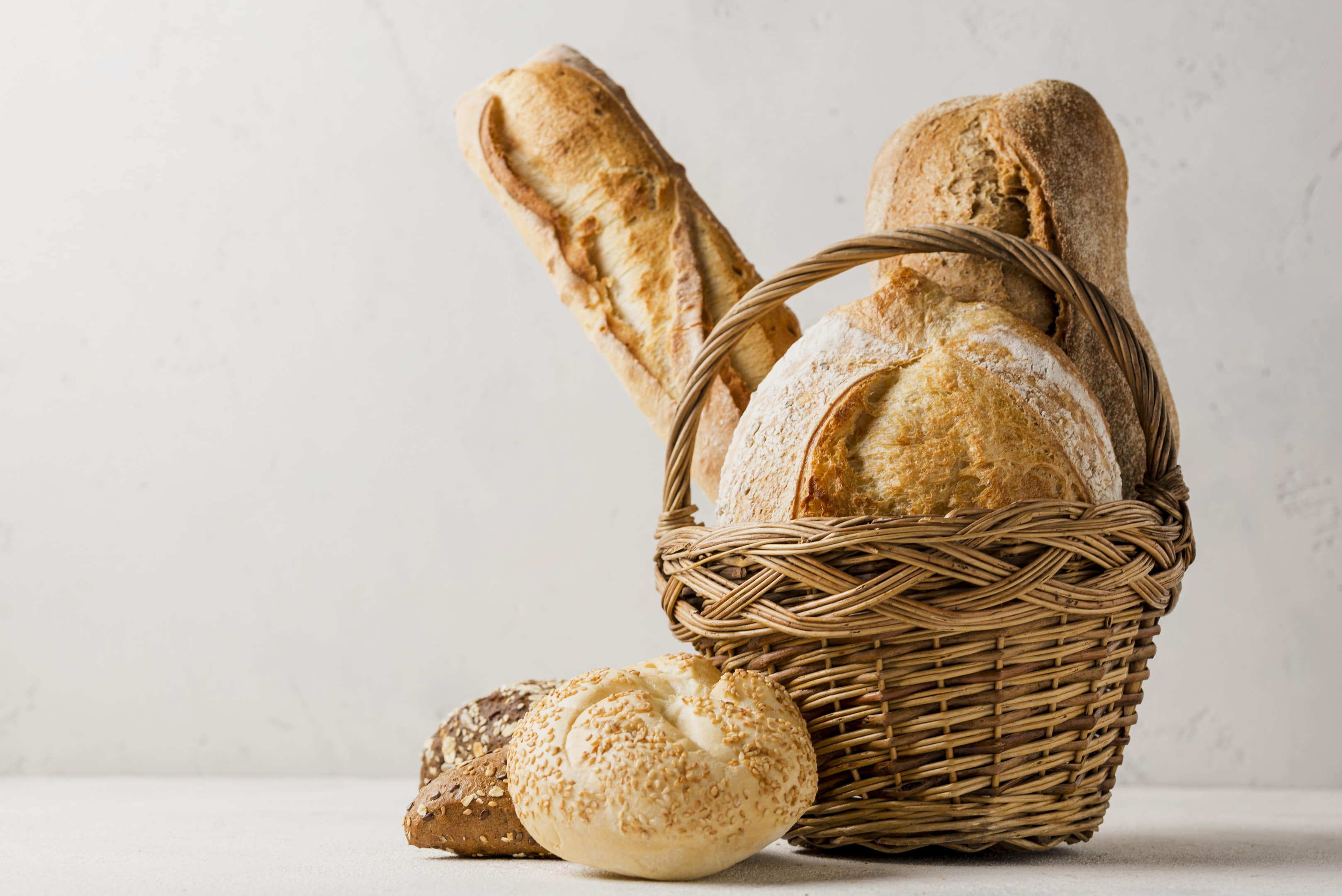 Basket with various white and whole grain breads