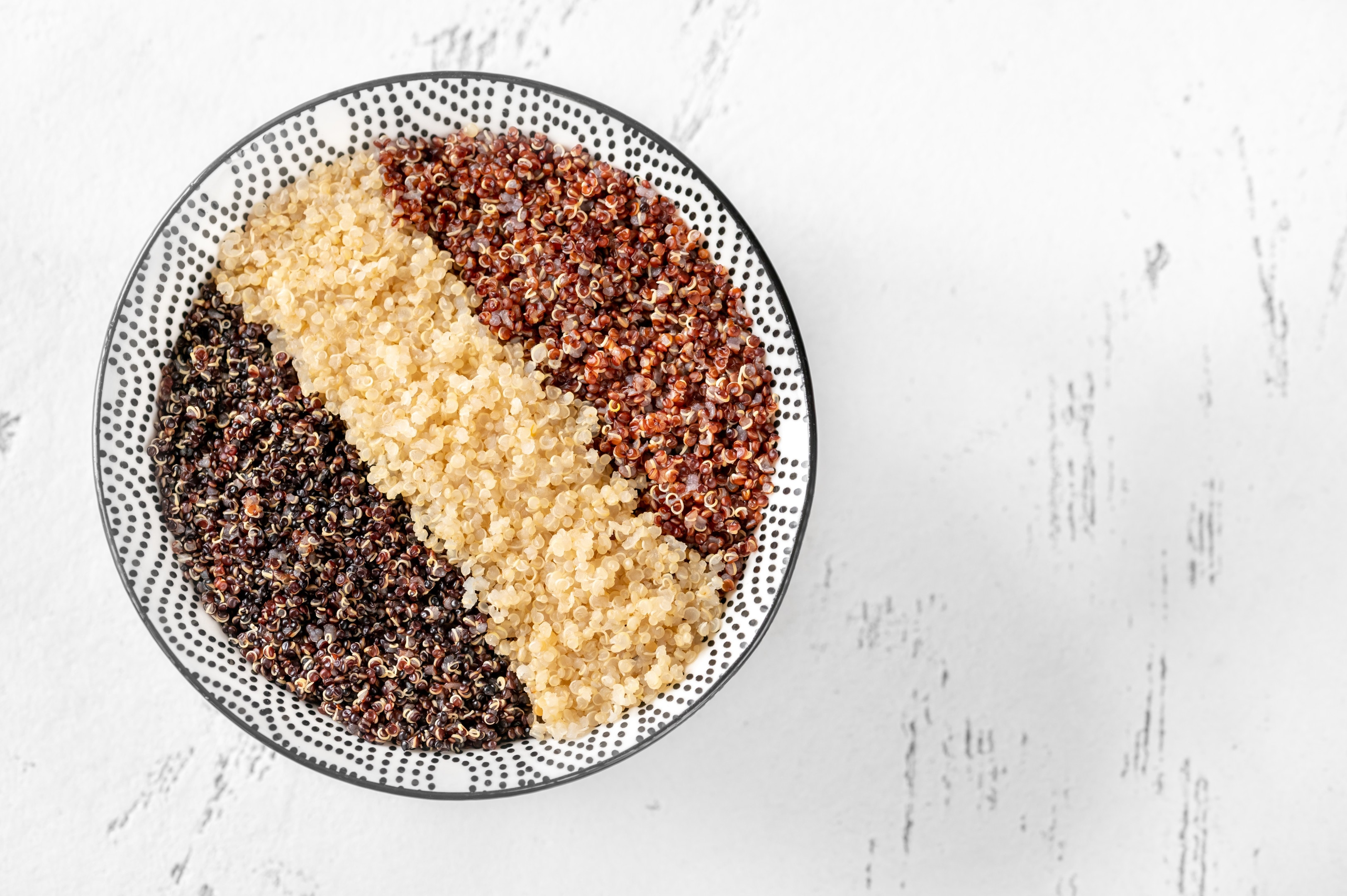Bowl with white red and black cooked quinoa