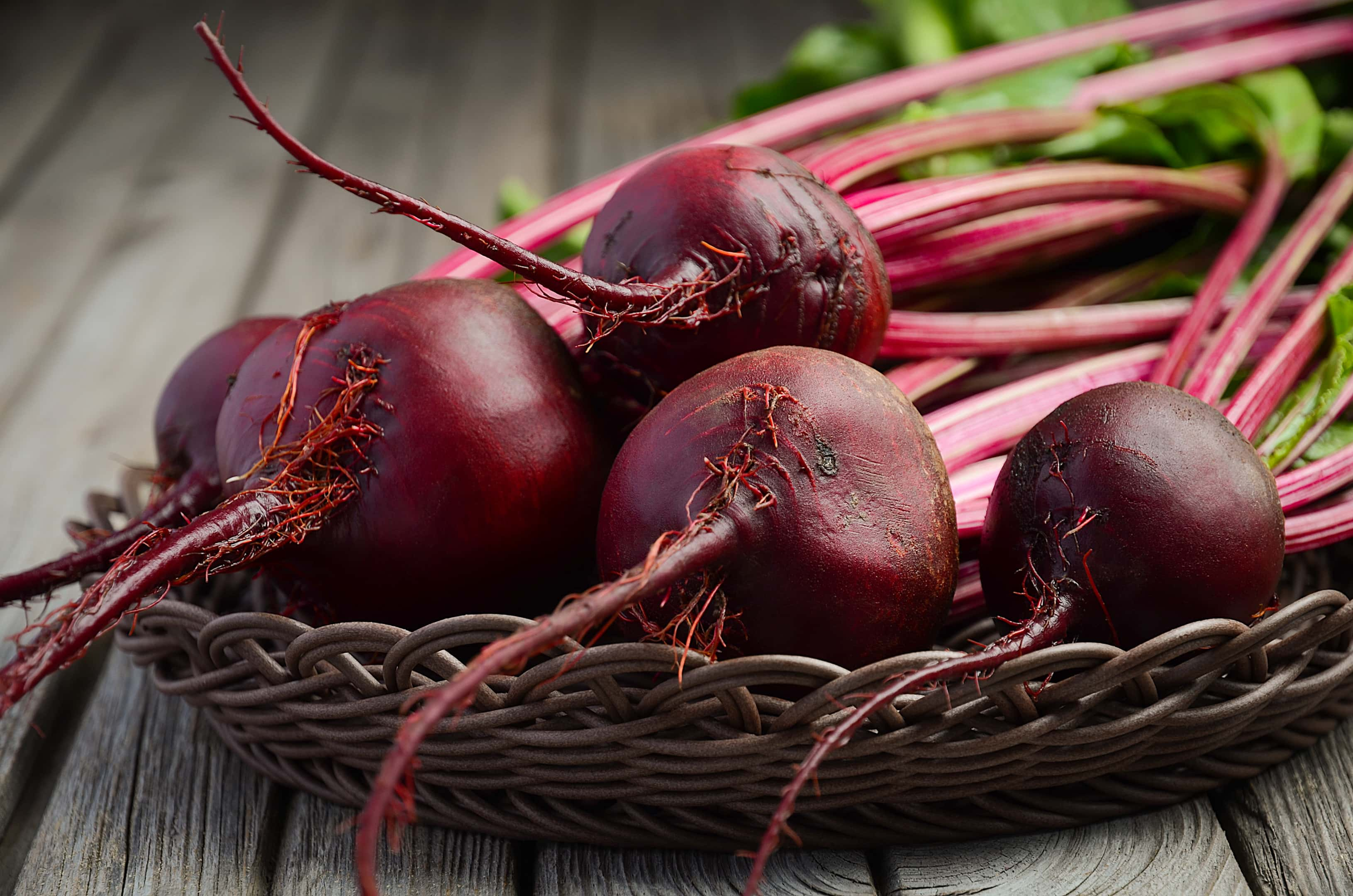 Fresh beets on rustic wooden table