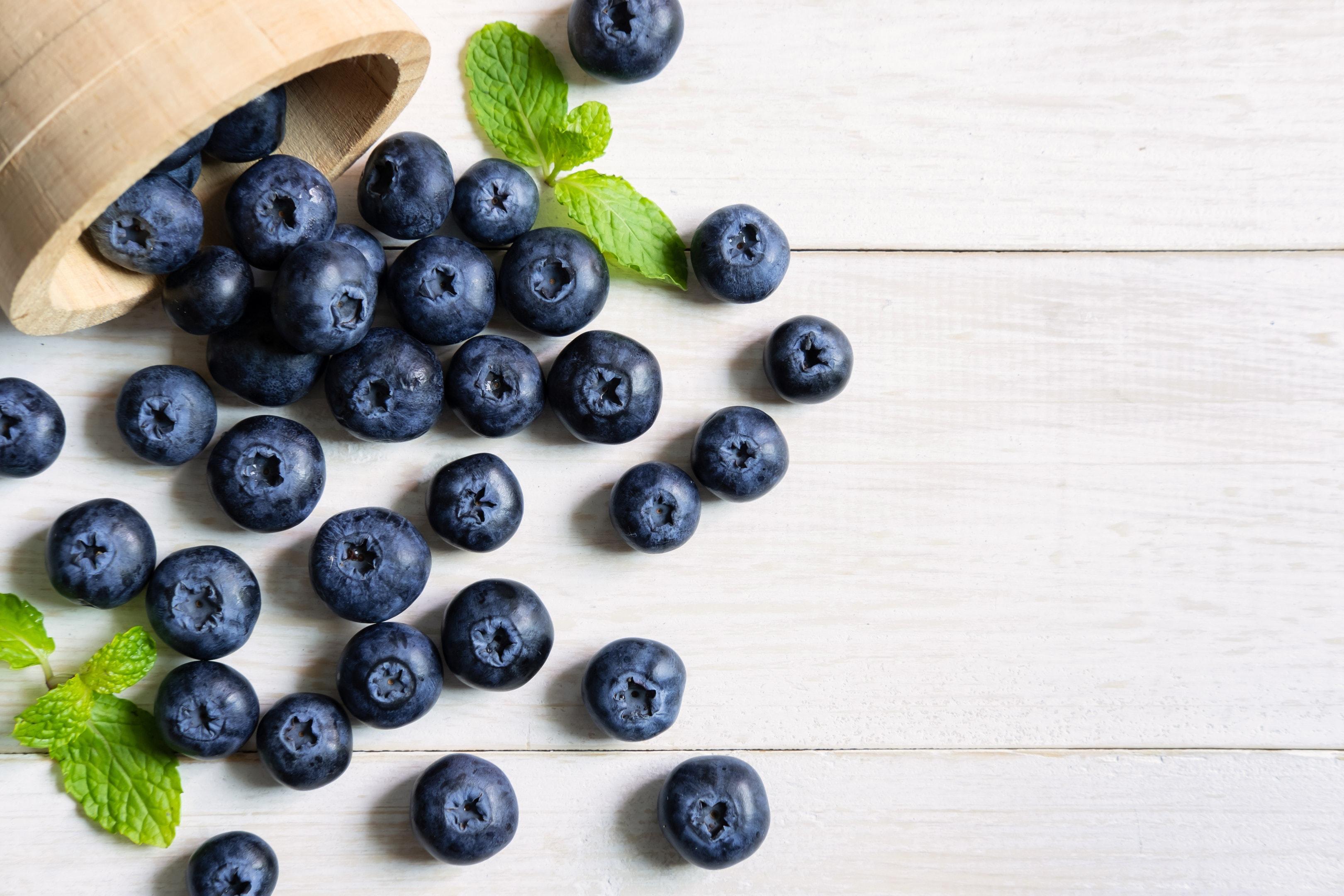 Fresh blueberries on white wooden table