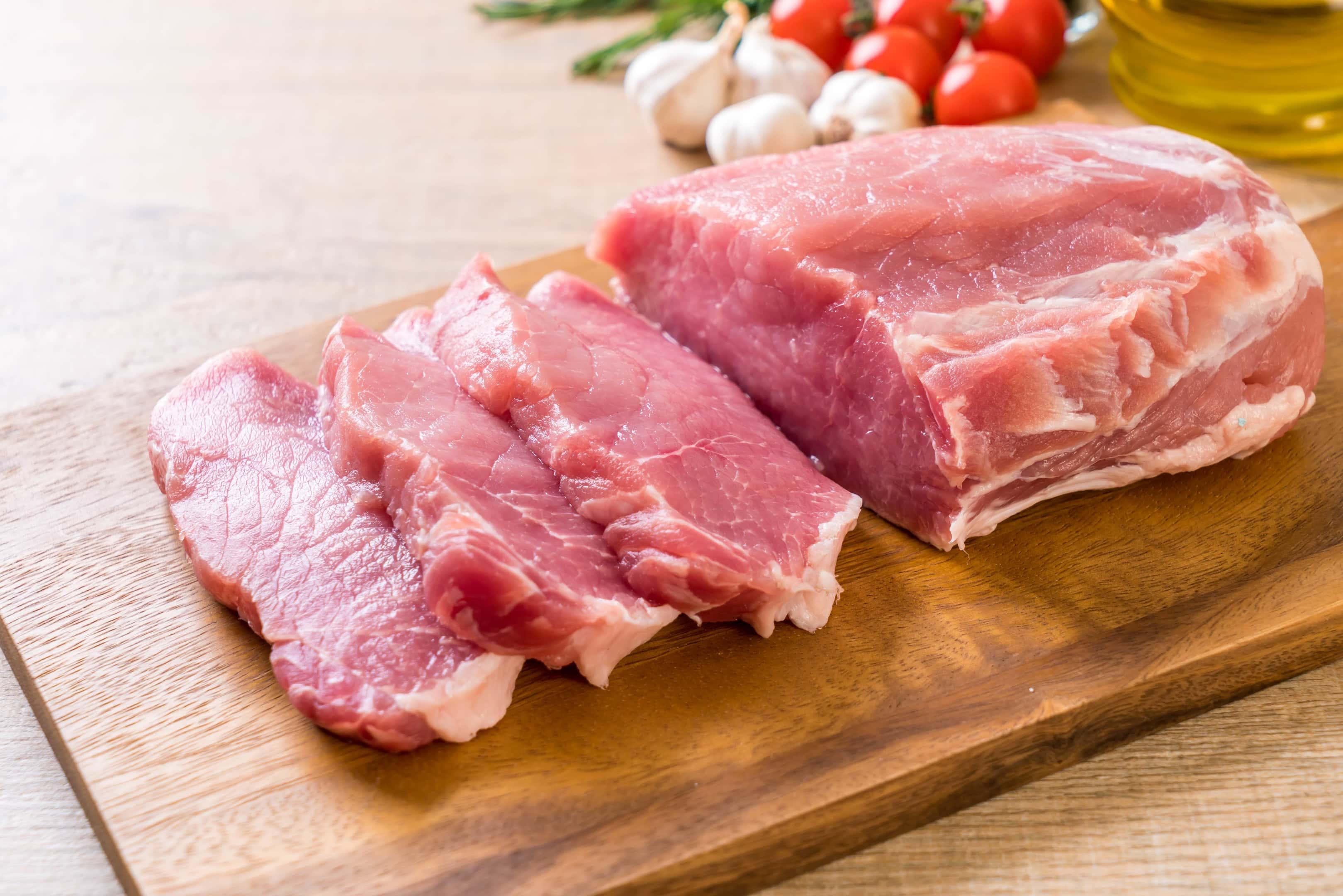 Fresh pork raw fillet on wooden board