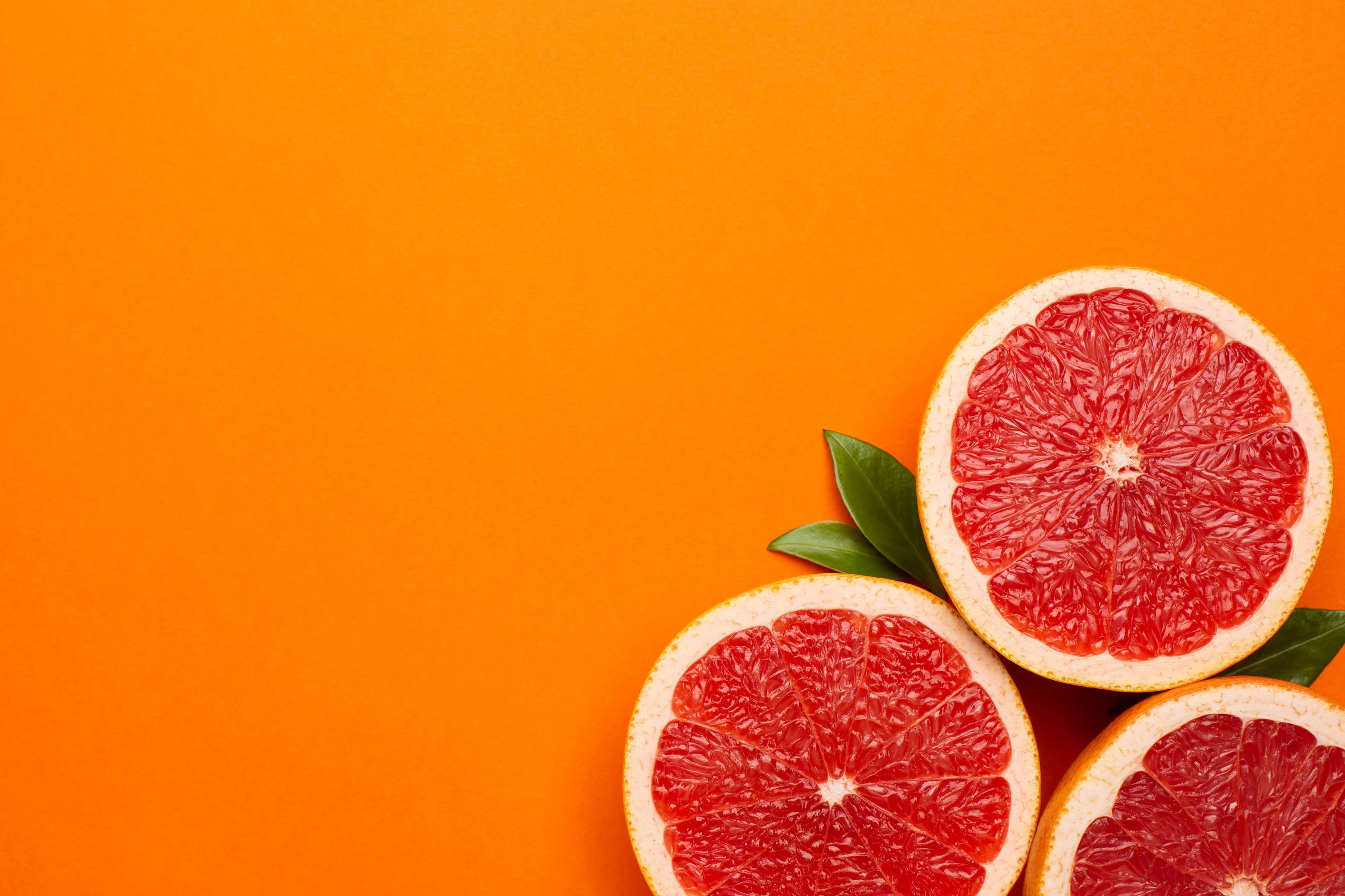 Grapefruits on orange background