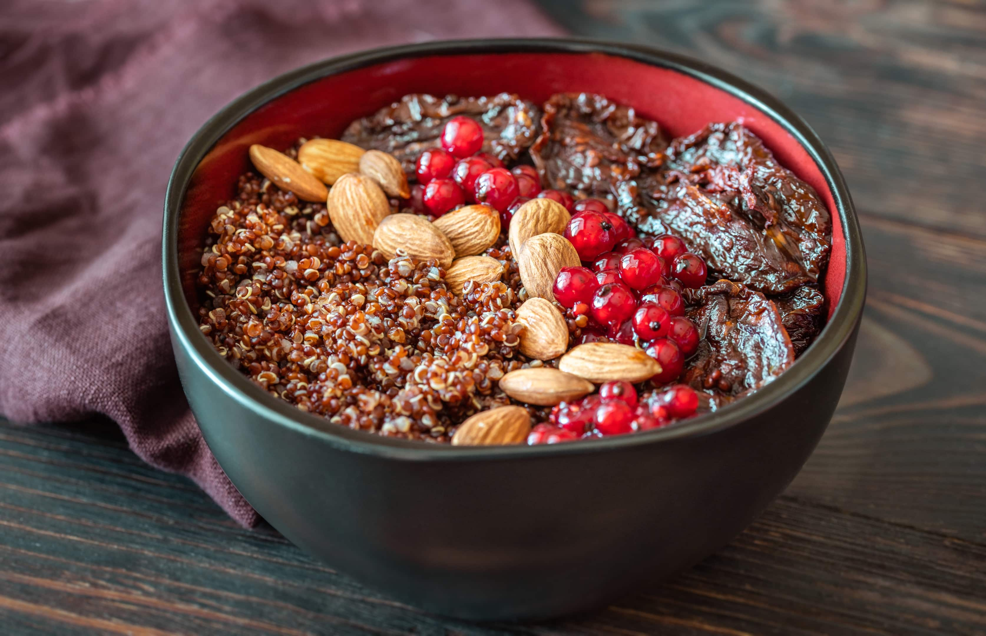 Bowl With Red Quinoa Olives Sun Dried Tomatoes Berries and Almonds